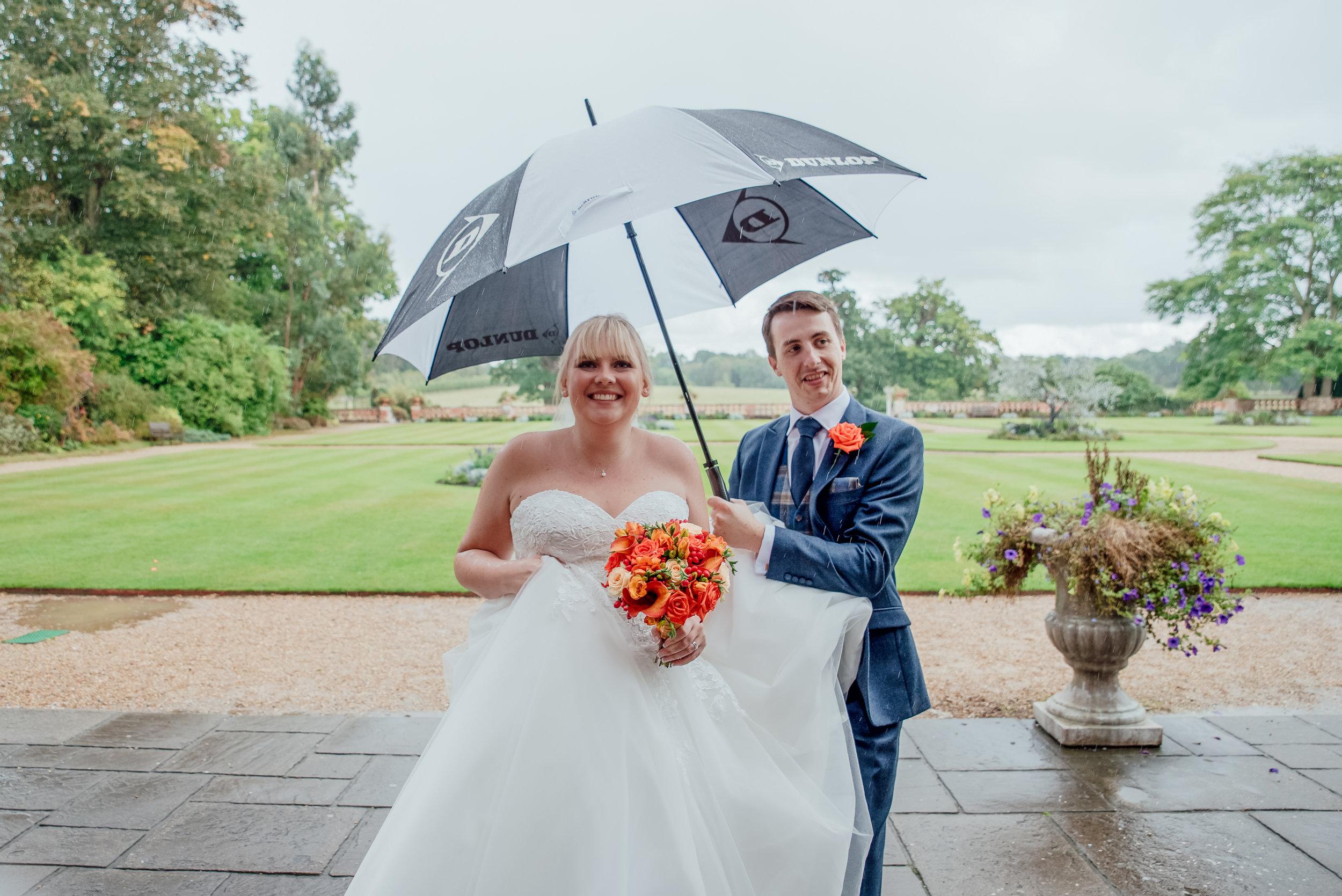 Bride and Groom in the rain at The Elvetham Fleet Hampshire Wedding Venue - Amy James Photography - Wedding Photographer for Hampshire and Surrey