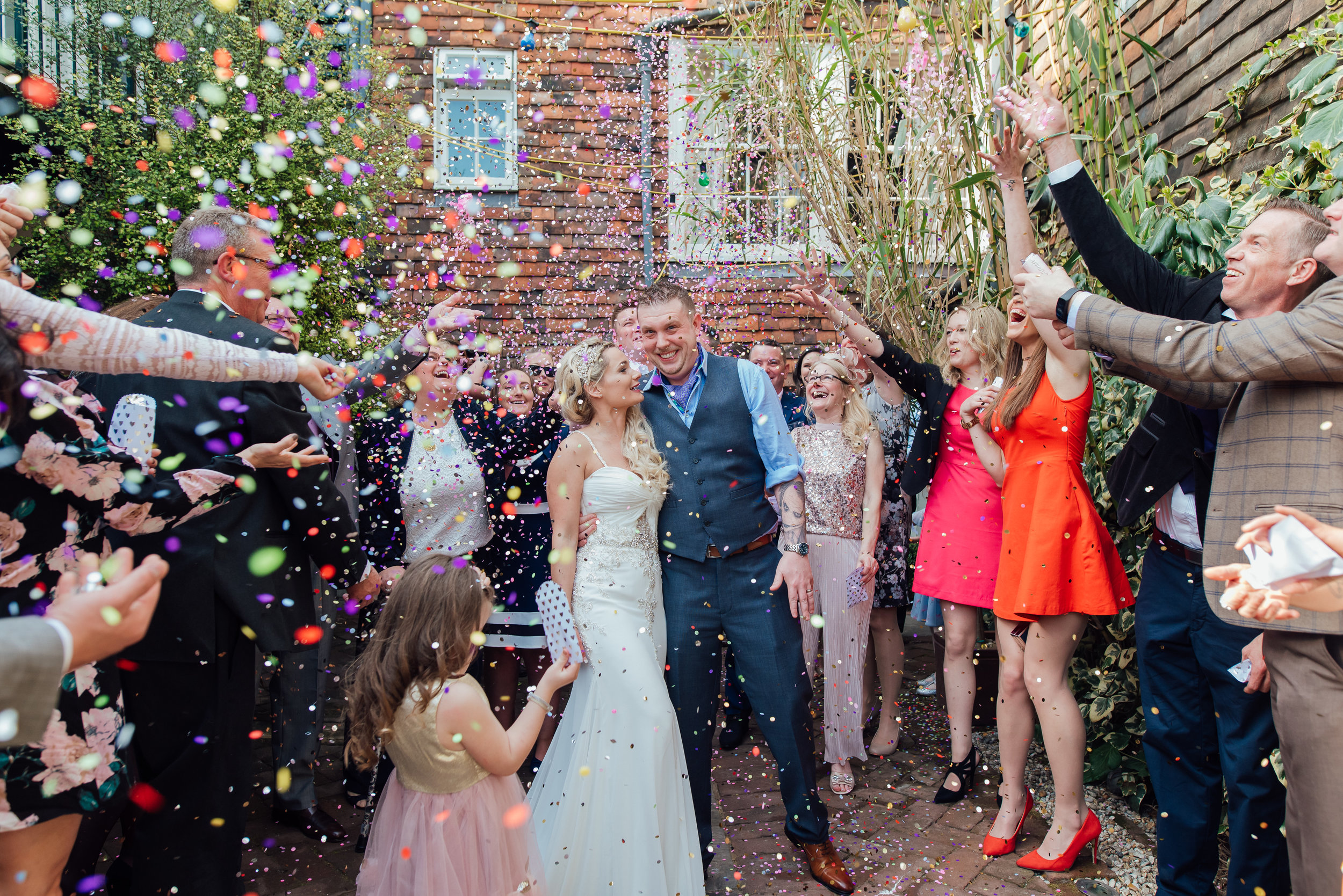 Brightly coloured wedding confetti photo - Amy James Photography - Documentary wedding photographer Hamphisre Surrey and Berkshire - The George in Rye Wedding