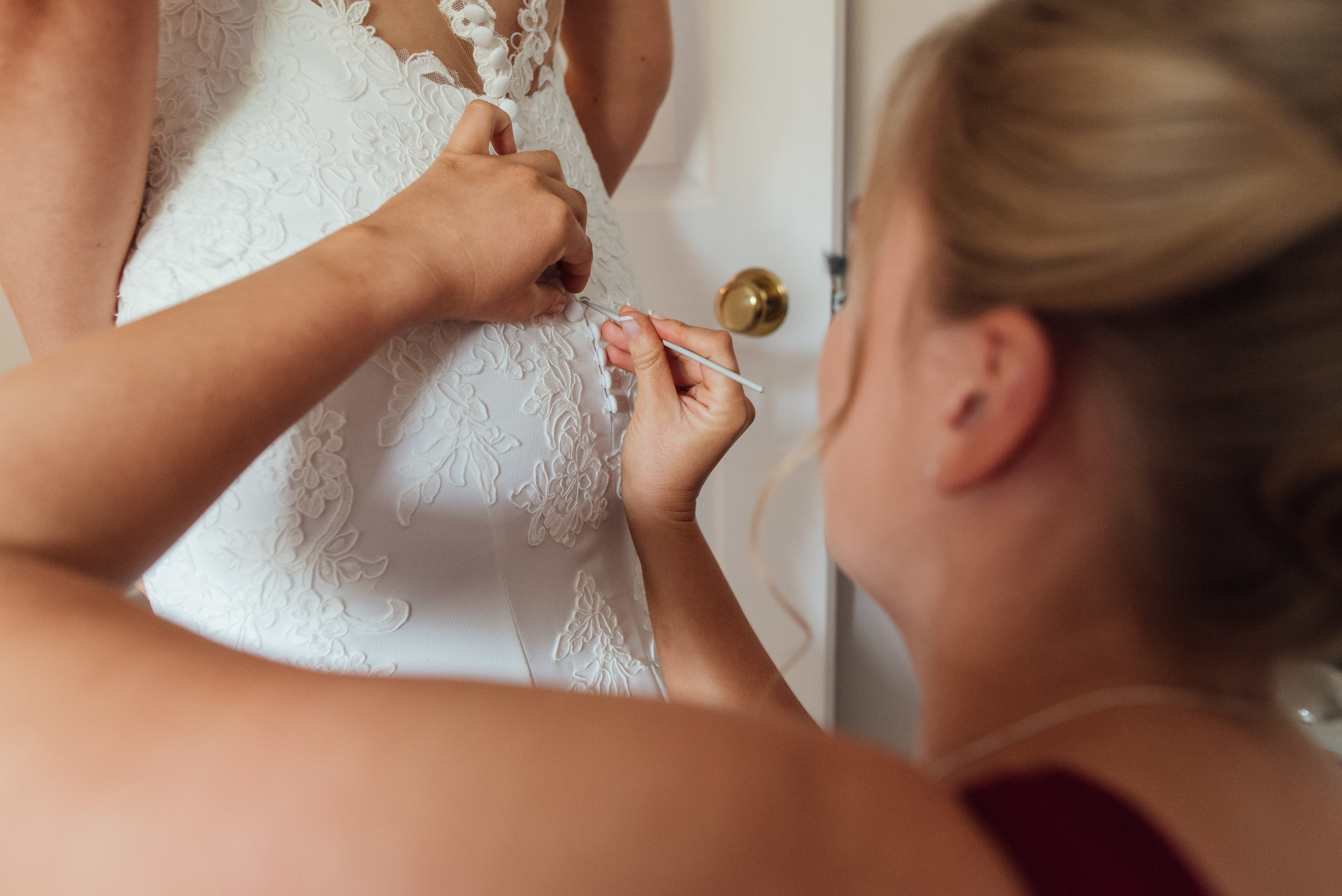 Bride-getting-int-wedding-dress-hampshire-wedding-photographer-amy-james-photography