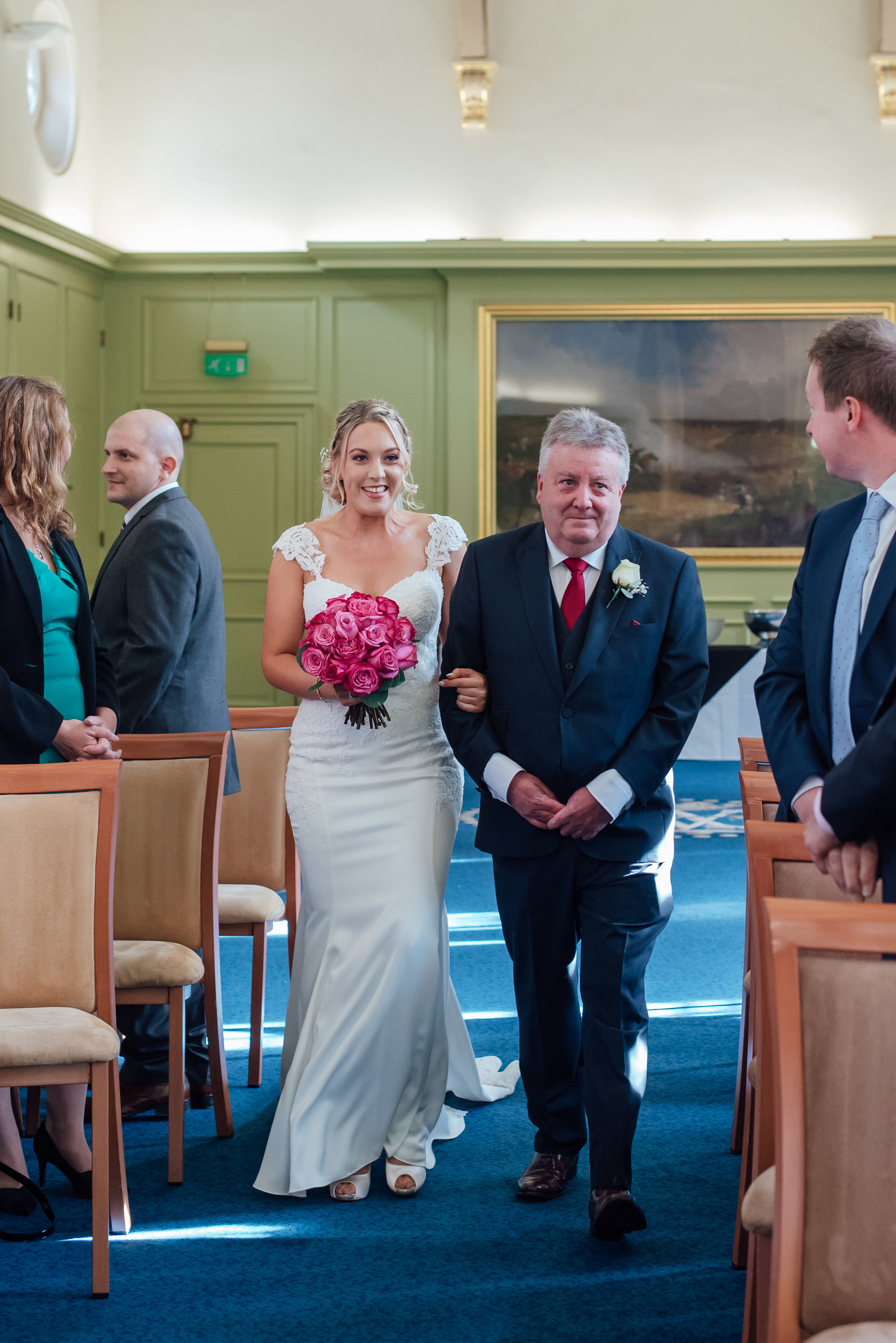 bride-walking down-aisle-with-her-father /Hampshire-wedding-photographer-hampshire / Amy-james-photography / fleet-wedding-photographer / fleet-photographer-farnborough / documentary-wedding-photographer / Hampshire-wedding-venue / wellington-college-wedding-berkshire