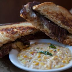2. Southern Reuben - This sandwich is served with one side. Which yummy side? Well that's up to you. Enjoy smoked beef brisket with BBQ 1000 island, sauerkraut and white cheddar on sourdough.