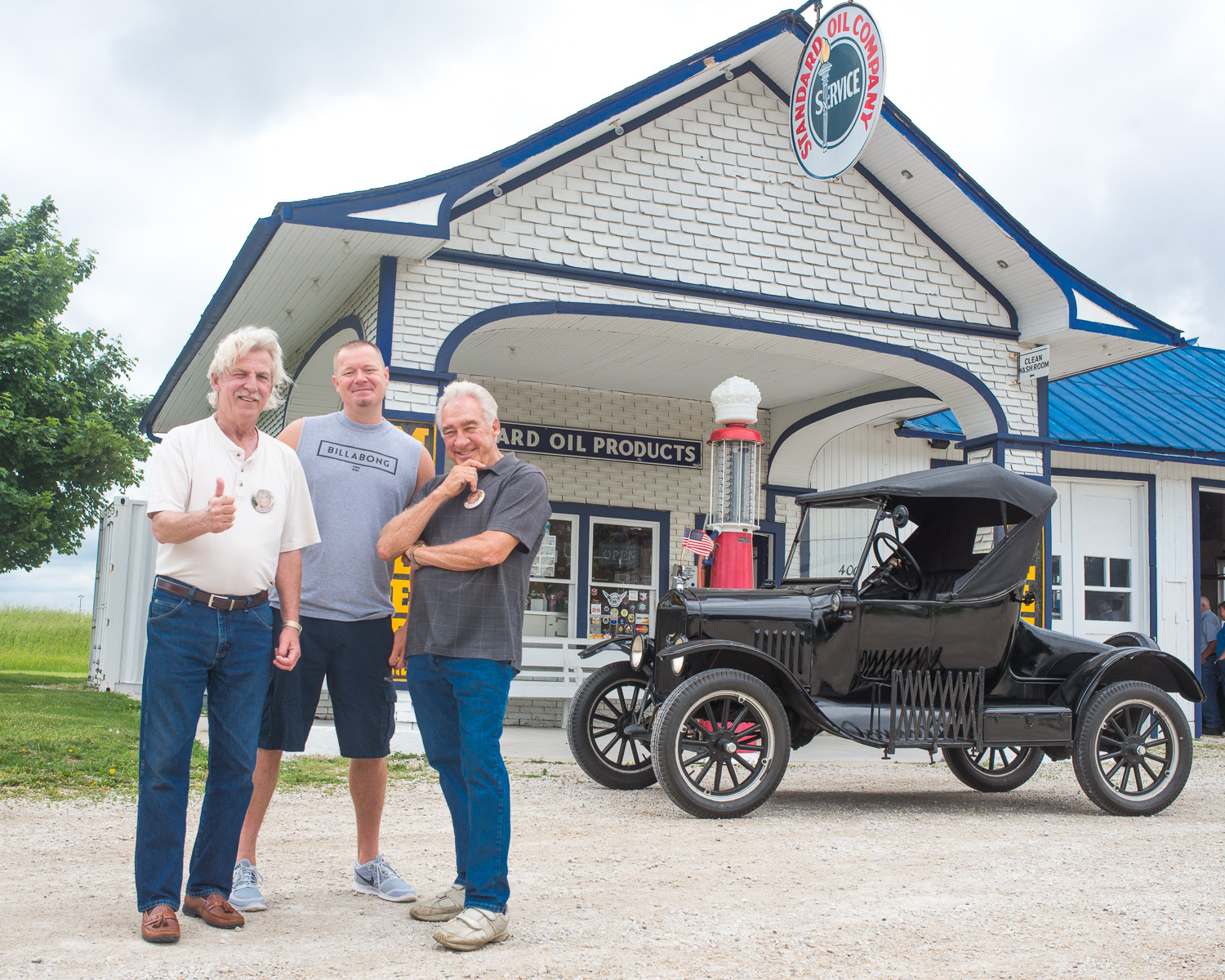 Craig Parrish, the event organizer, John Weiss, 66 preservationist  and husband of Lenore, and Terry Joiner, The Mayor of Odell in front of Odell Station with a Ford Model T.