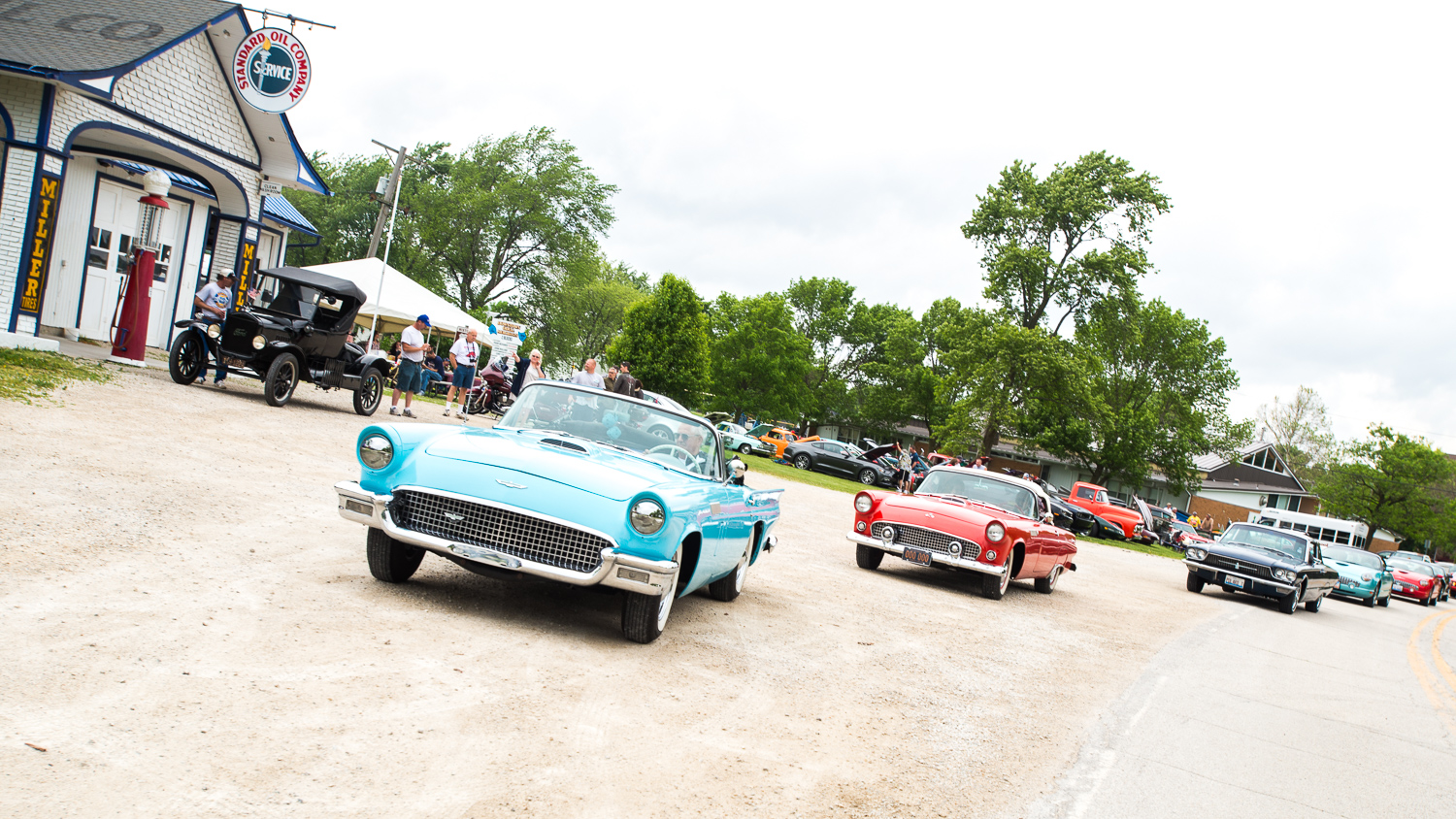 A String of Ford Thunderbirds arriving at The Car Show Benefit.