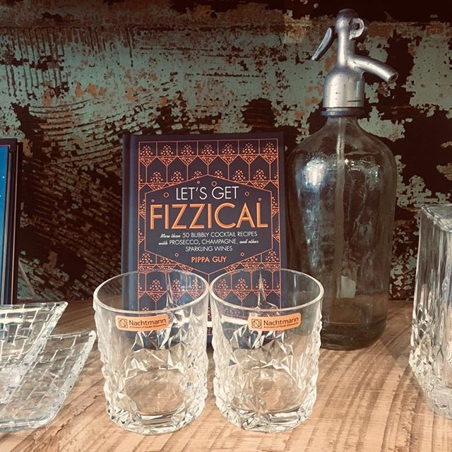 Bar books, rocks glasses and a lovely antique seltzer bottle. #bartending #cocktails #fun #berkshiremade