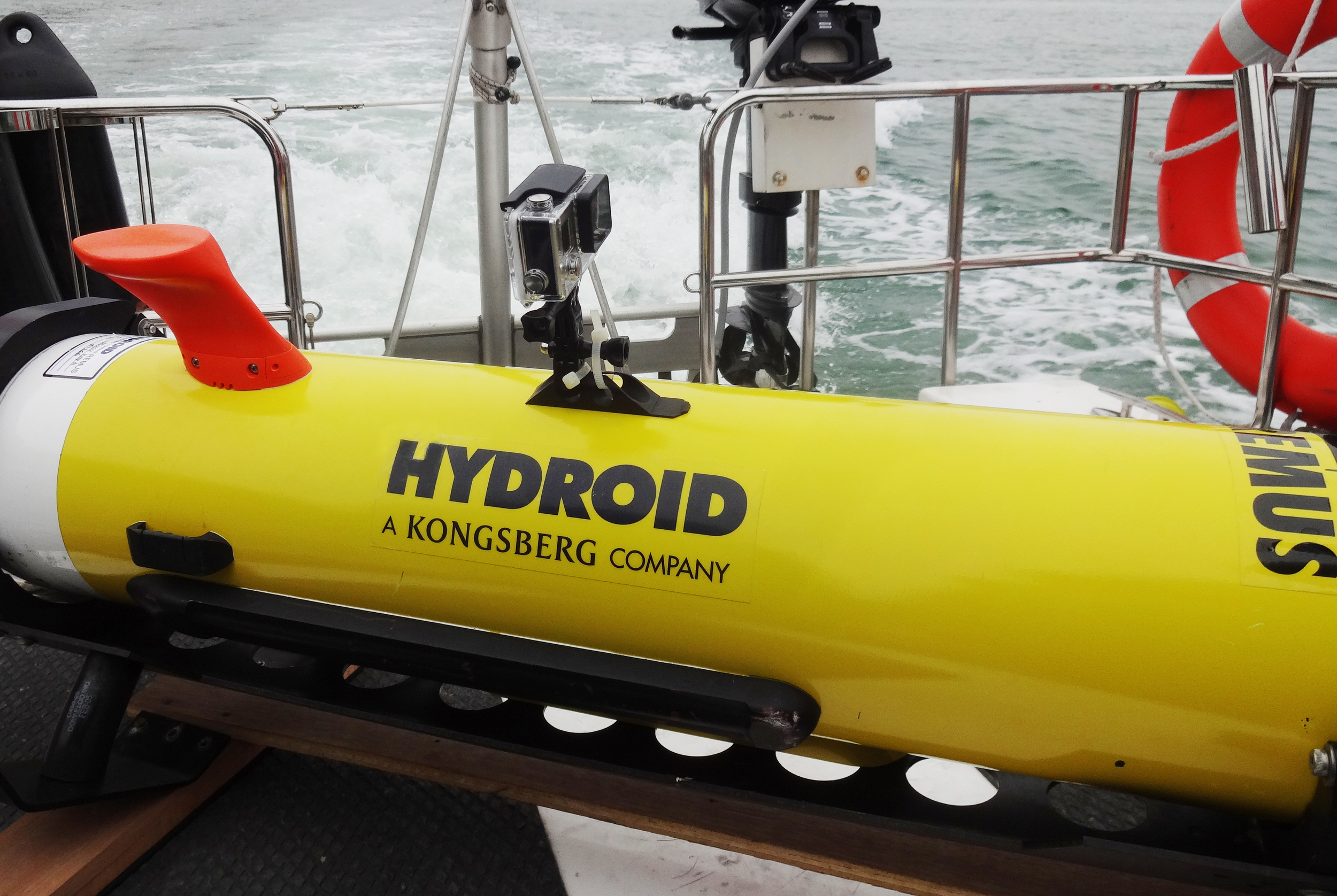 Photo: REMUS 100 AUV on deck before launching. Photo courtesy of Hydroid, Inc.