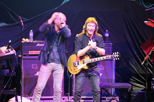 Normally stoic Steve Hackett laughing and clapping his hands instead of playing guitar