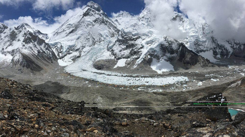 Everest's black pyramid towering 2 miles above basecamp
