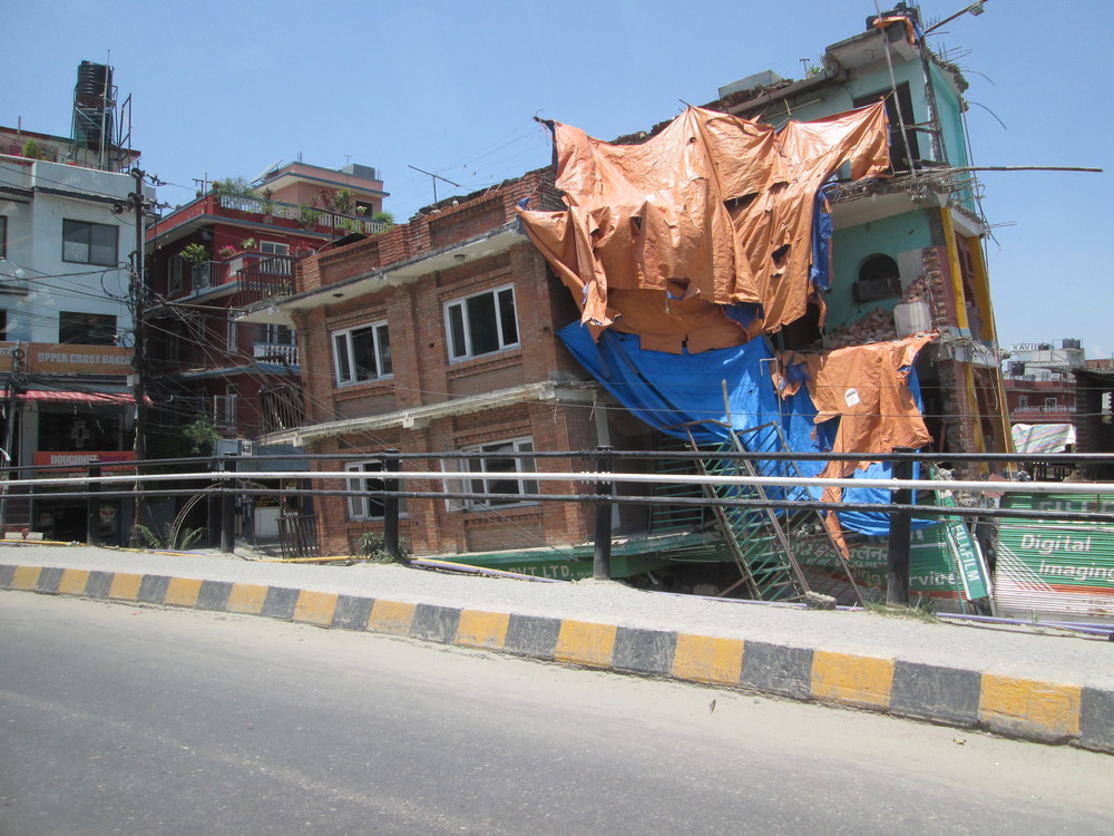 Above: Earthquake damage in Katmandu; the first floor of this building gave way