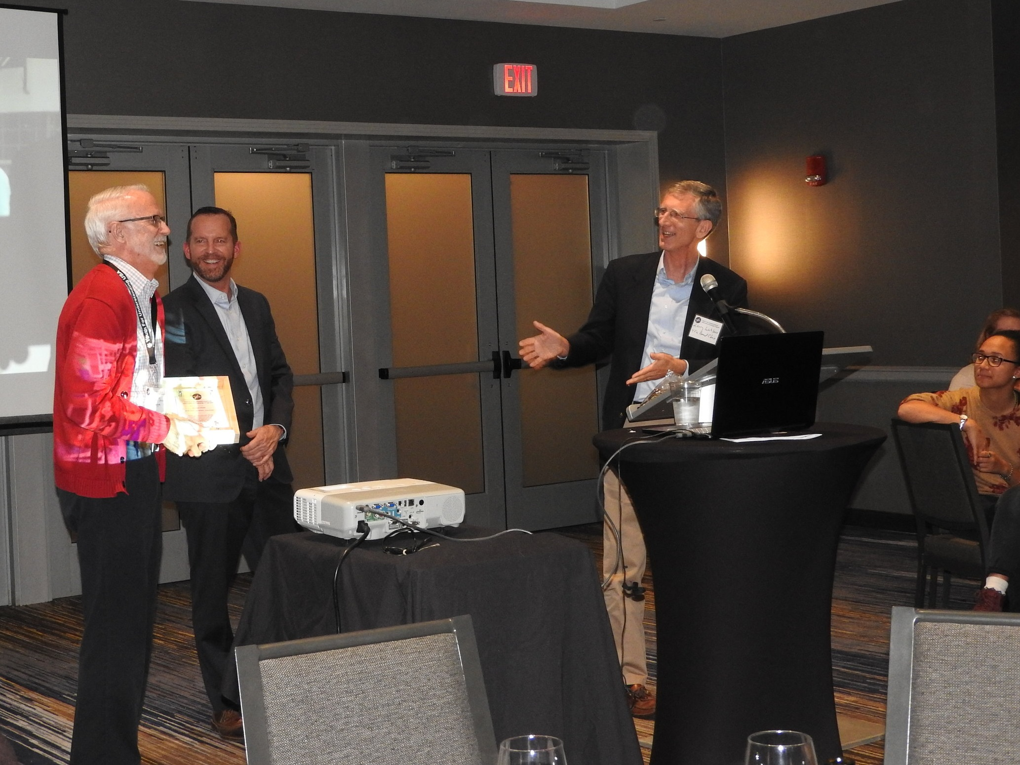 Gordon Snow receives the 2018 Distinguished Volunteer Award from Scott Messing and Ambassador Laurence Wohlers.