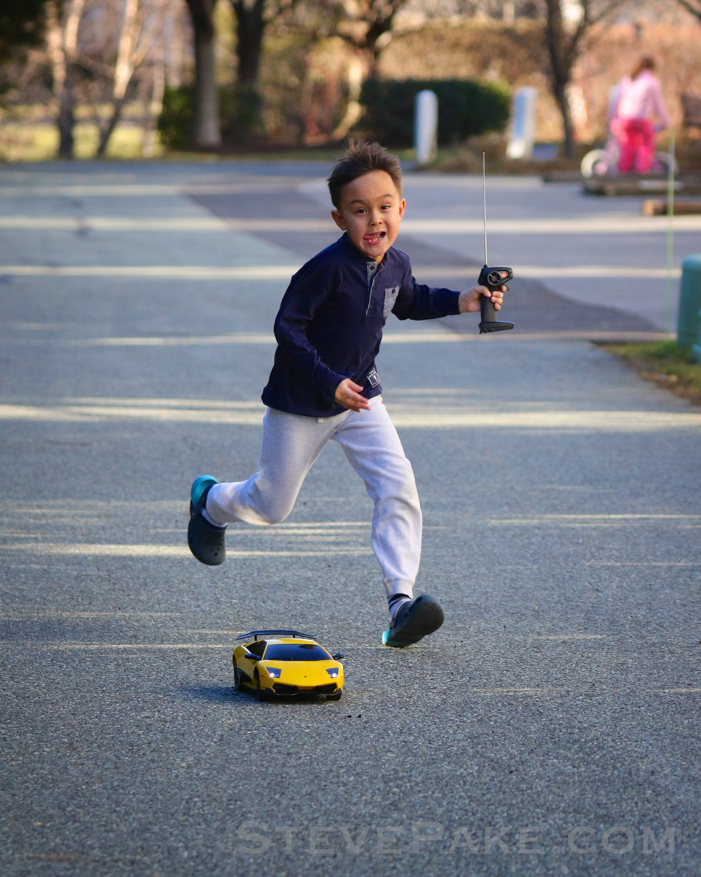 William chasing his remote control Lamborghini. Check out his expression, and the fact that his legs are both in the air and surrounding his car. This was the perfect look and the perfect timing. :) Canon 7D Mark II and 100-400mm lens.