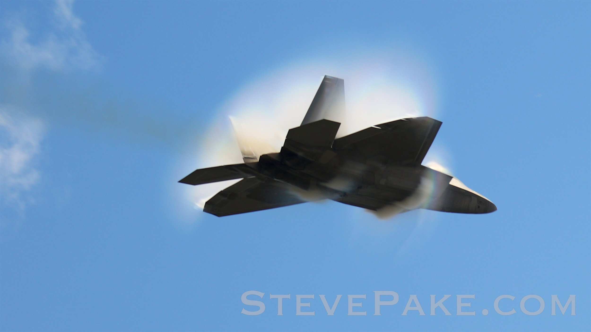 "Prize Shot: The transonic F-22 Raptor pass. It's just stunning! This was right over our heads at a focal length of only 135mm, so my cheap 18-135mm kit lens could have gotten this shot! It helps to have top notch equipment, but you don't ""need"" to have exotic super telephoto lenses to get great photos!!!"