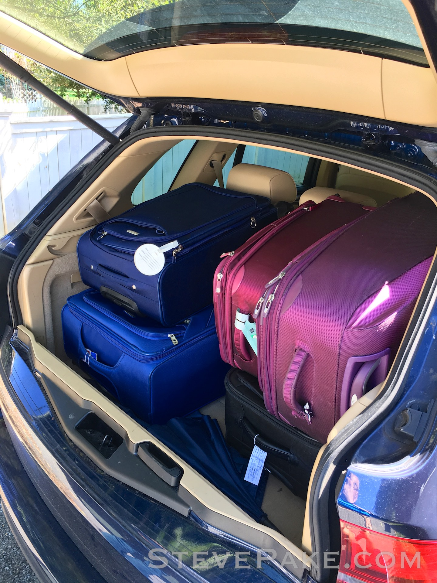 Our 2012 BMW X5 with the same five international trip rigid bags, with room to spare for all the extras!