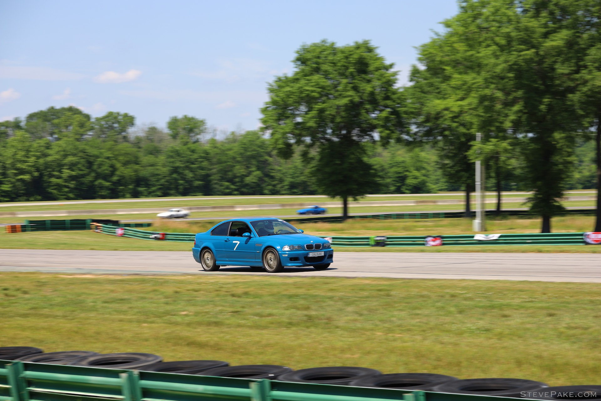 This blue E46 M3 was gorgeous. 1/160s between Turns 4 and 5.