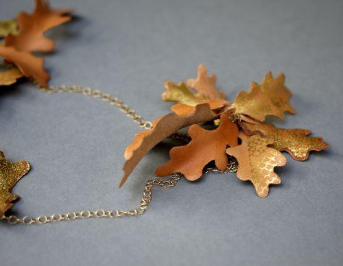 Gilded leather oak leaf pendant