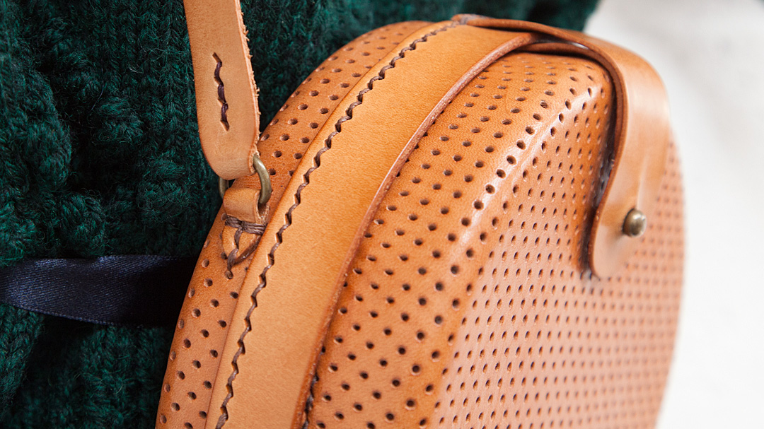 Hand-stitched perforated bag detail