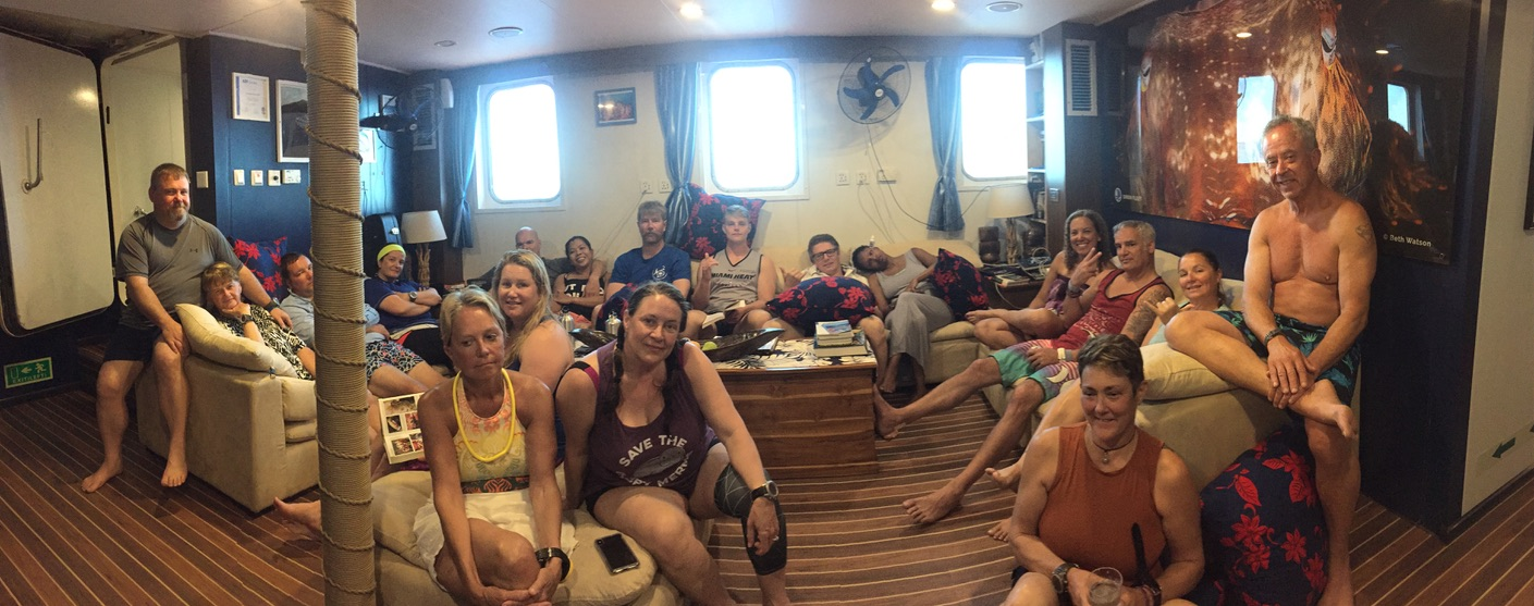 Our crew awaiting another exciting dive briefing in the salon of the French Polynesia Master.