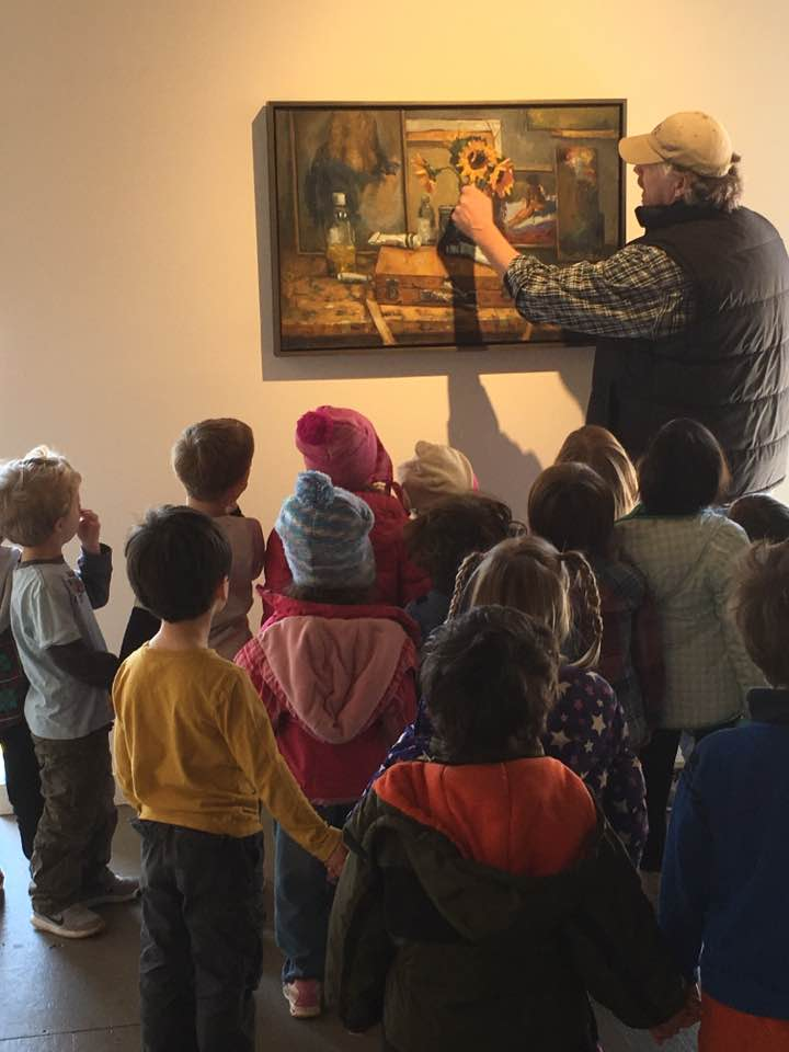 """Frank Bruckmann plays """"I-Spy"""" with preschoolers during class visit."""