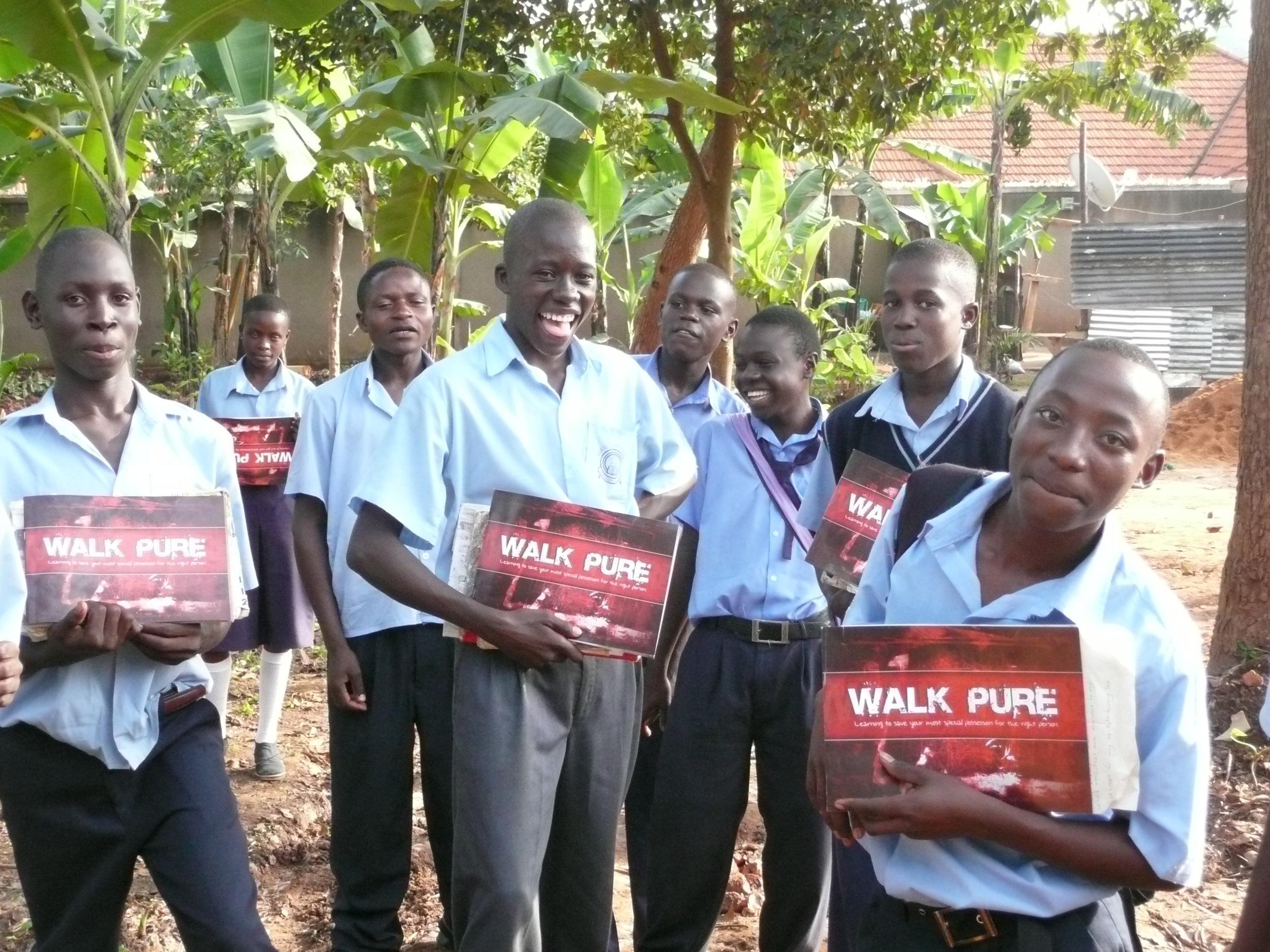 Students holding Walk Pure books.JPG