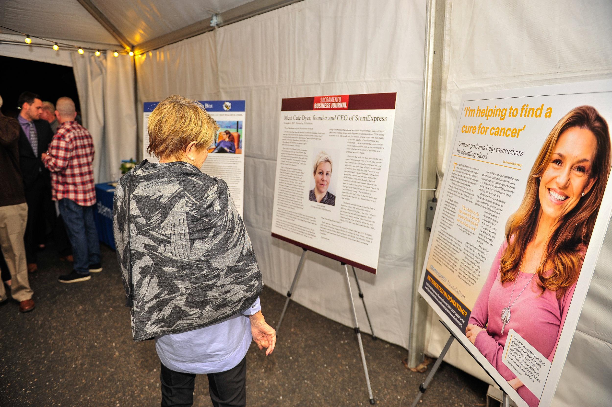 A guest reading publications on StemExpress achievments.