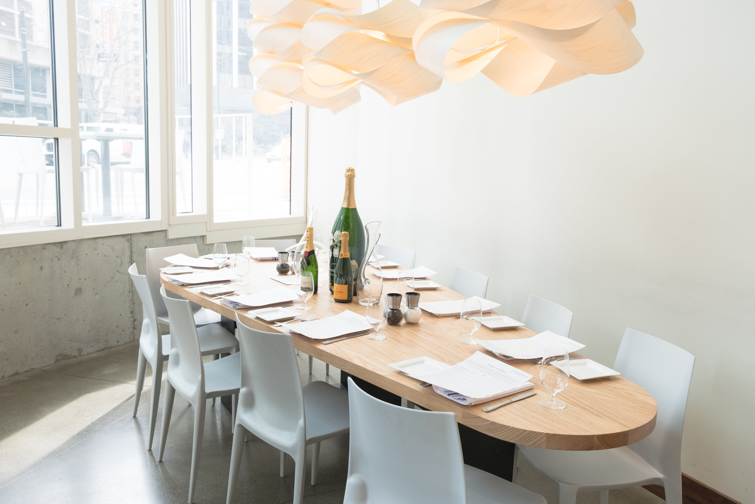 "Our ""Table 8"" communal table seats up to 12 guests comfortably and discreetly in a corner on the main floor"