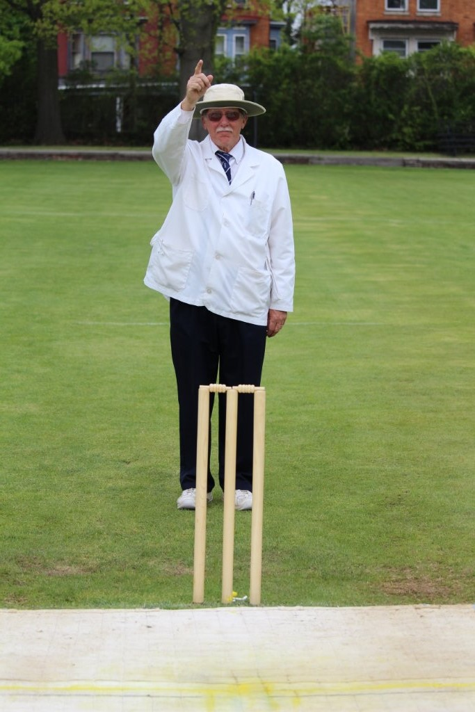 Umpire responds to the appeal by sticking a finger in the air, signaling the batsman is out Leg Before Wicket. (Photo by Ewart Rouse. All rights reserved.)