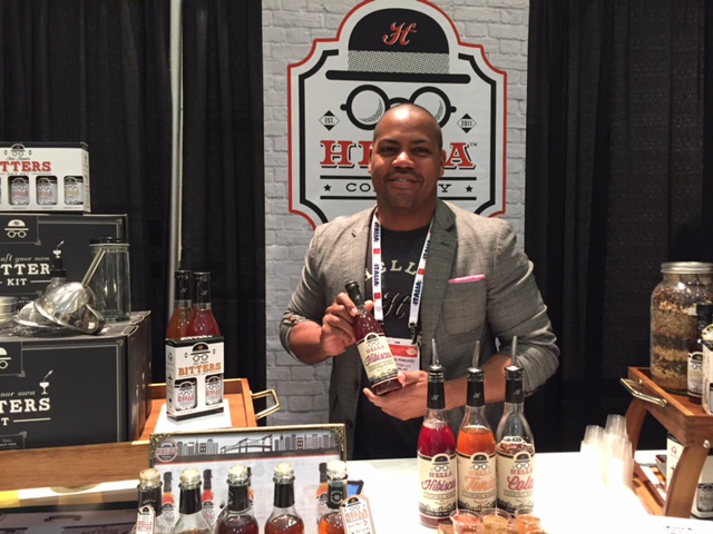 Jomaree Pinkard, co-founder of the Hella Cocktail Co., displays one of the company's new products at the Winter Fancy Food Show.