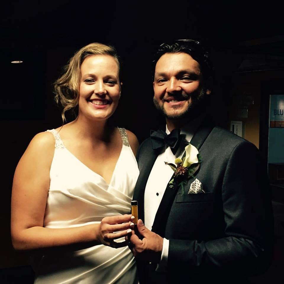 happy couple with their bespoke wedding perfume by Alchemologie