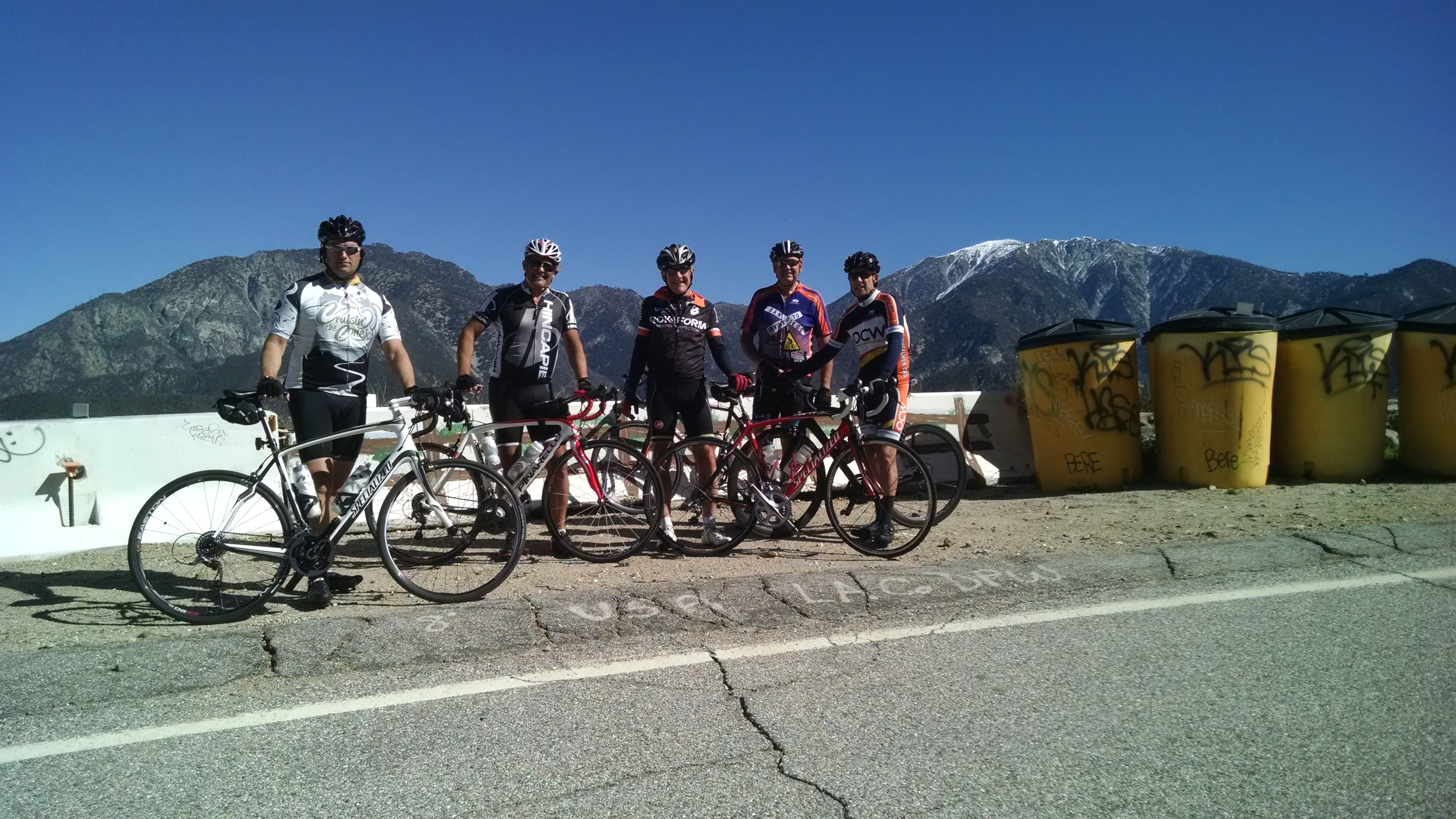 Sean, Vic and BCI members Vince Wilhelm, Jim Norman and Bruce Campbell taking a break in front of Mt. Baldy.