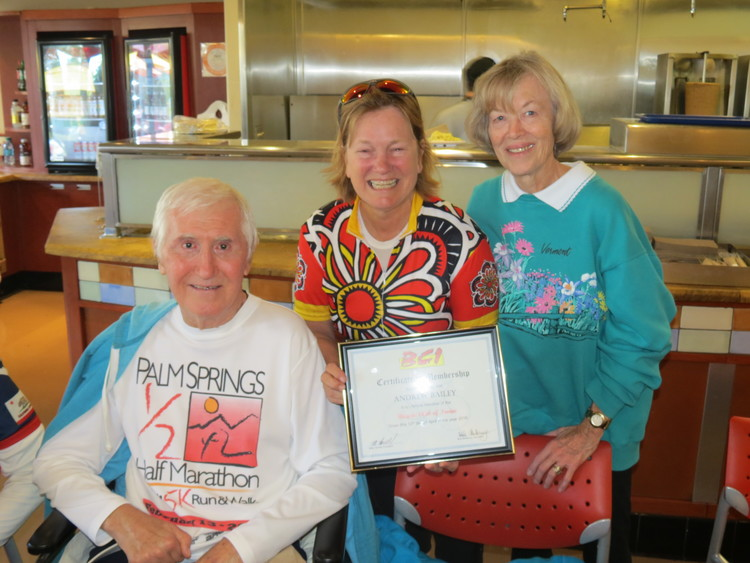 Penny (center) presenting Andy and Jeri with a lifetime membership certificate.