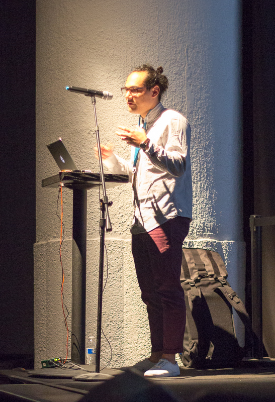 photo of Jono Brandel talking at Gray Area