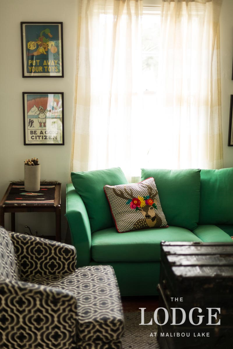 Green-Sofa-Coffee-Table-Trunk-Black-White-Patterned-Armchair.jpg