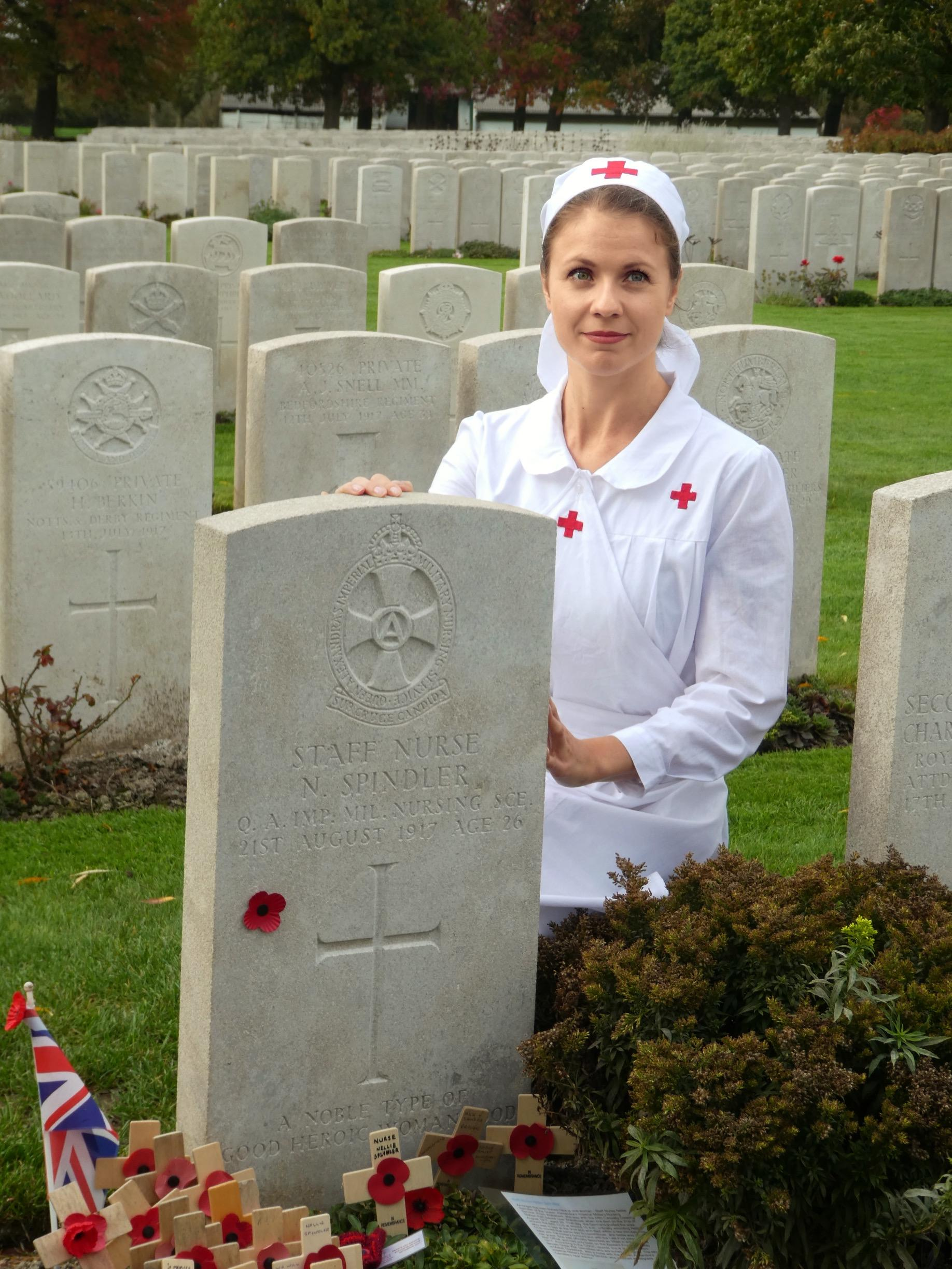 Simone Riksman, soprano in  The Healers,(Les Anges Blanc)   by the grave of Staff Nurse Spindler in France October 2017 during the concert season there.