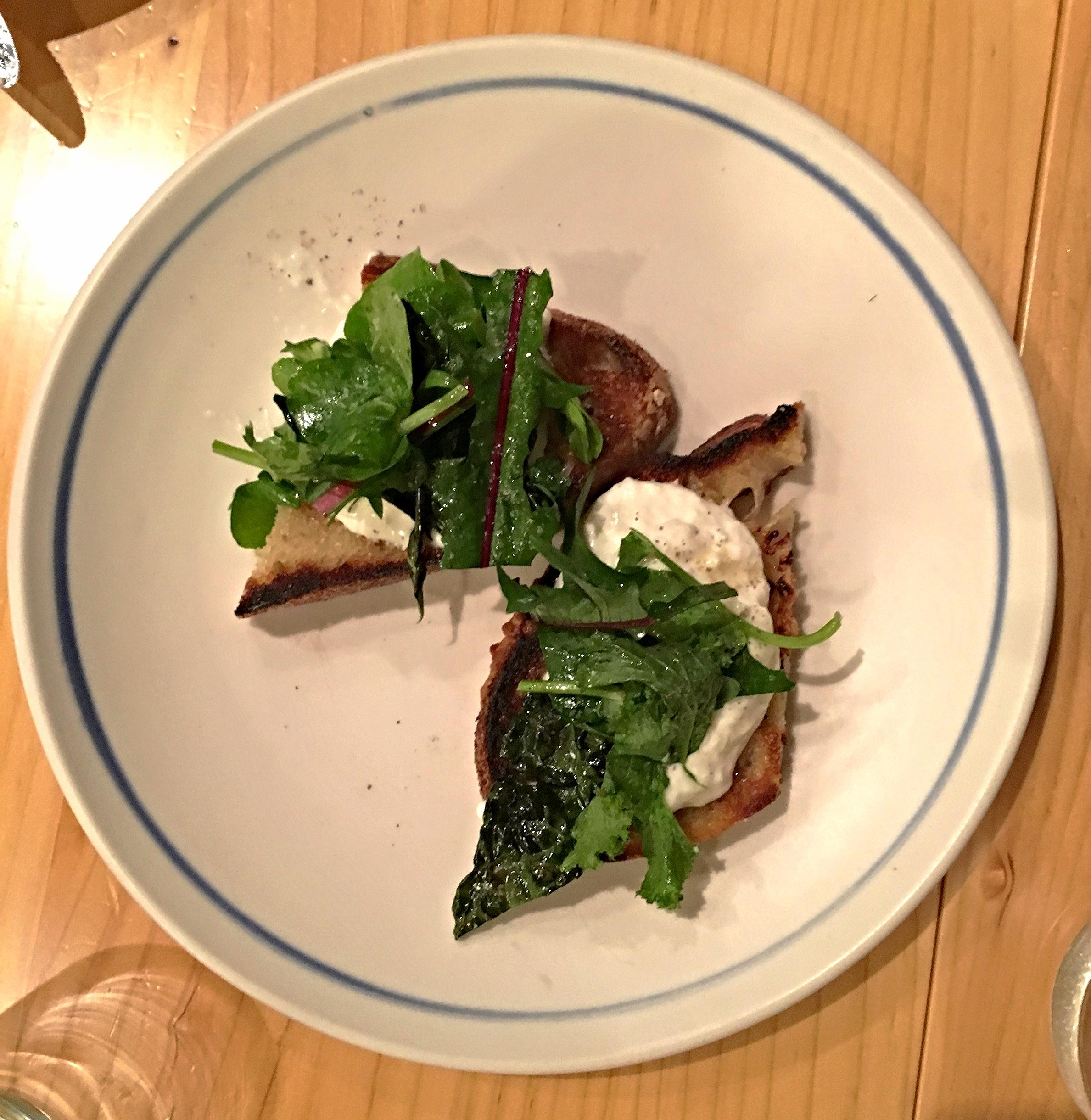 burrata toast, straciatella, kale, mustard frill, black butter
