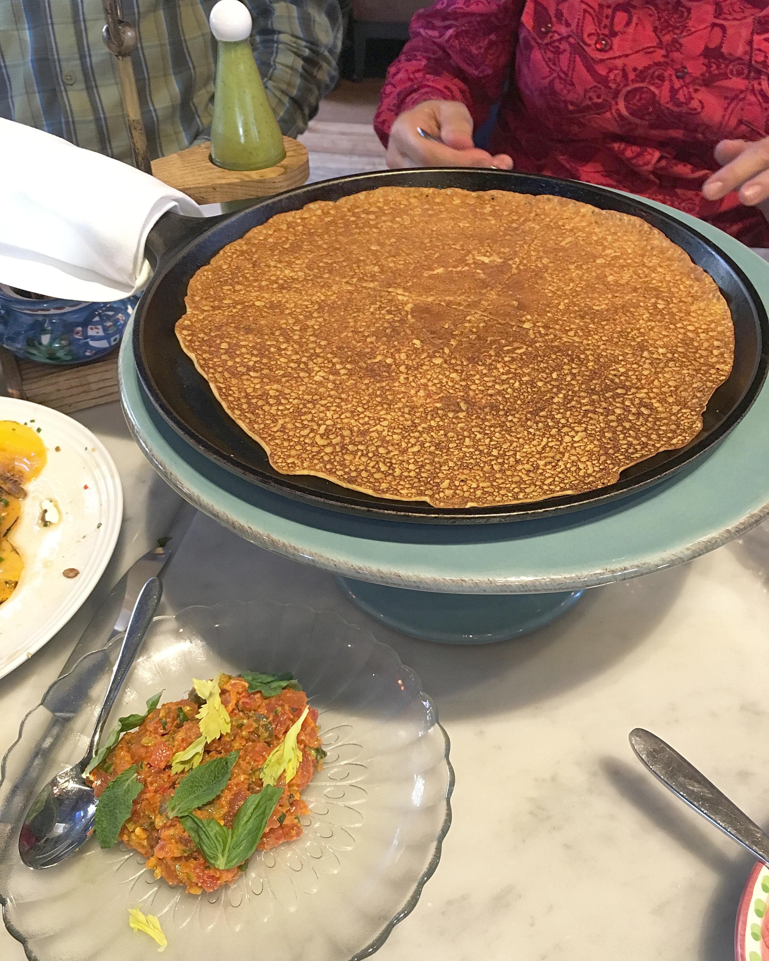 cecina (chickpea pancake), spicy calabrian tuna tartare, avocado salsa verde