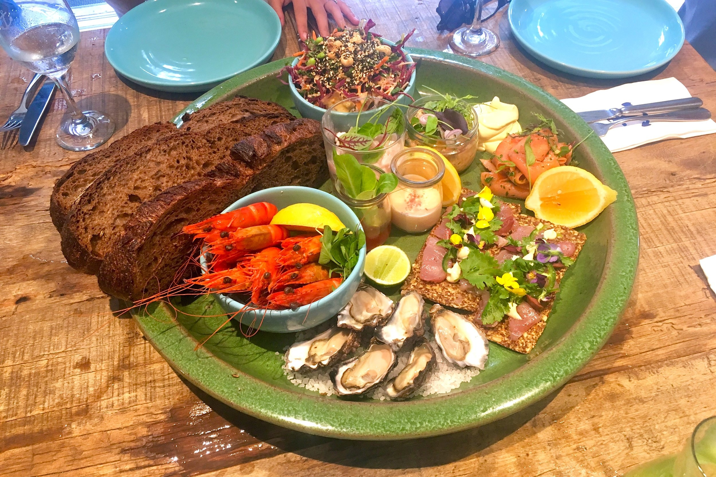 cold seafood platter // sydney rock oysters, tuna cracker, trout pate, smoked trout, QLD tiger prawns, kingfish ceviche, served with Boathouse salad + sourdough