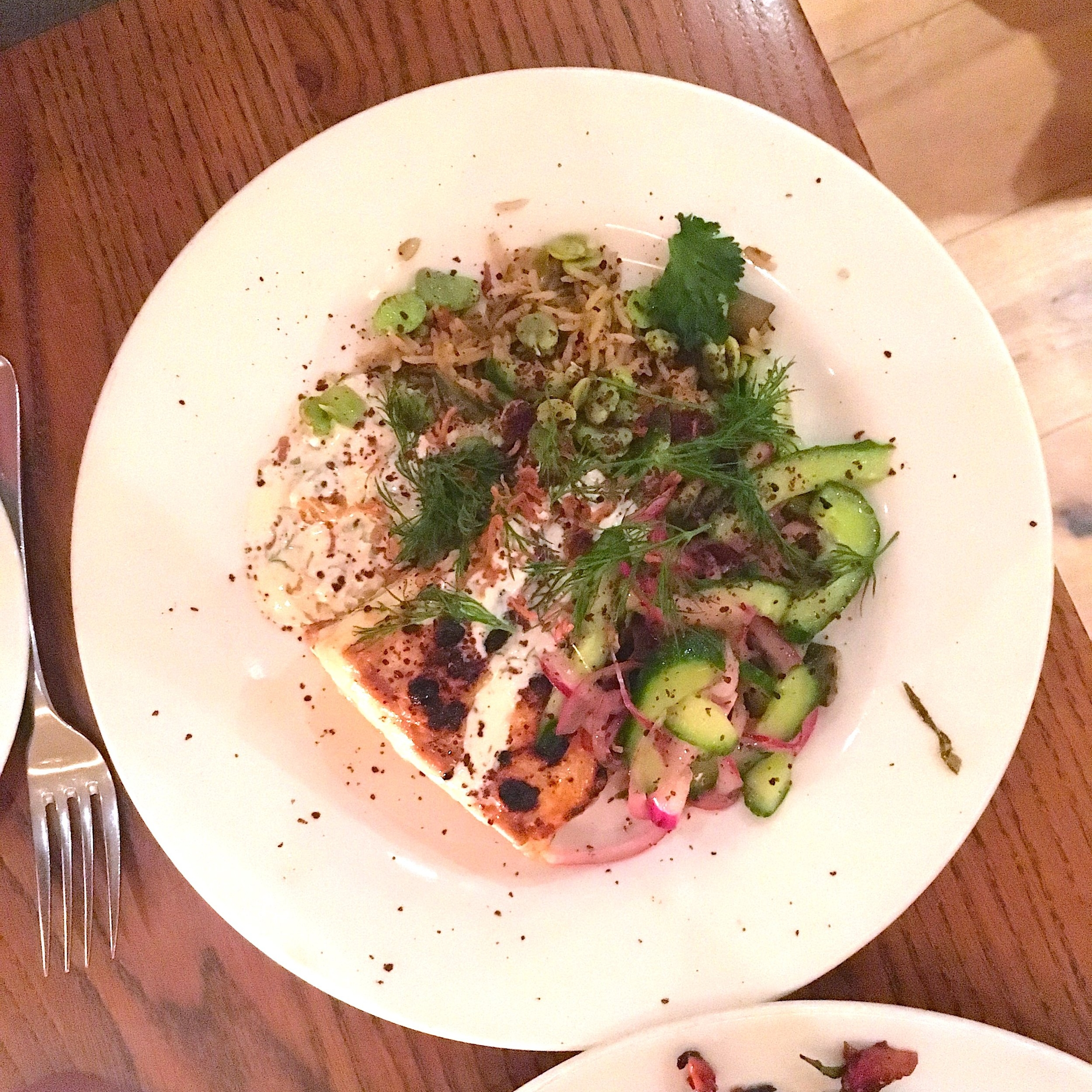 charcoal grilled halibut with broad bean pilav, spiced cucumber & red onion salad, and dill yoghurt