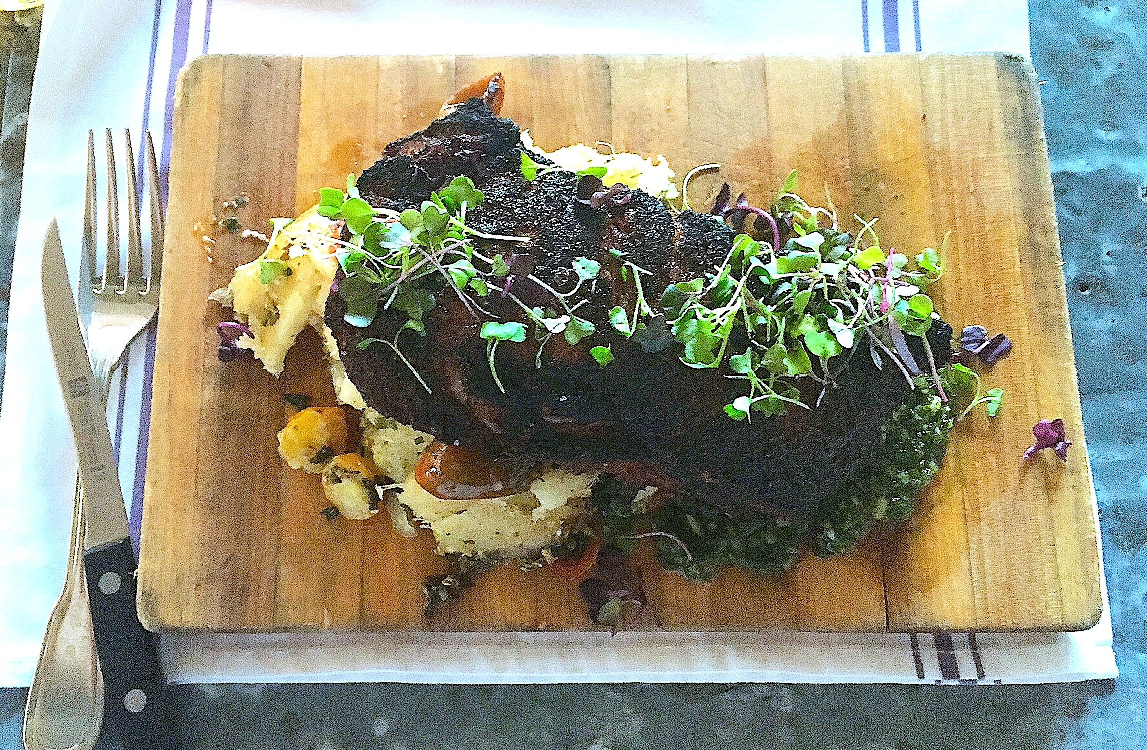 16 oz. espresso rubbed dry-aged rib eye // oven roasted yucca, baby heirloom tomatoes, house chimichurri