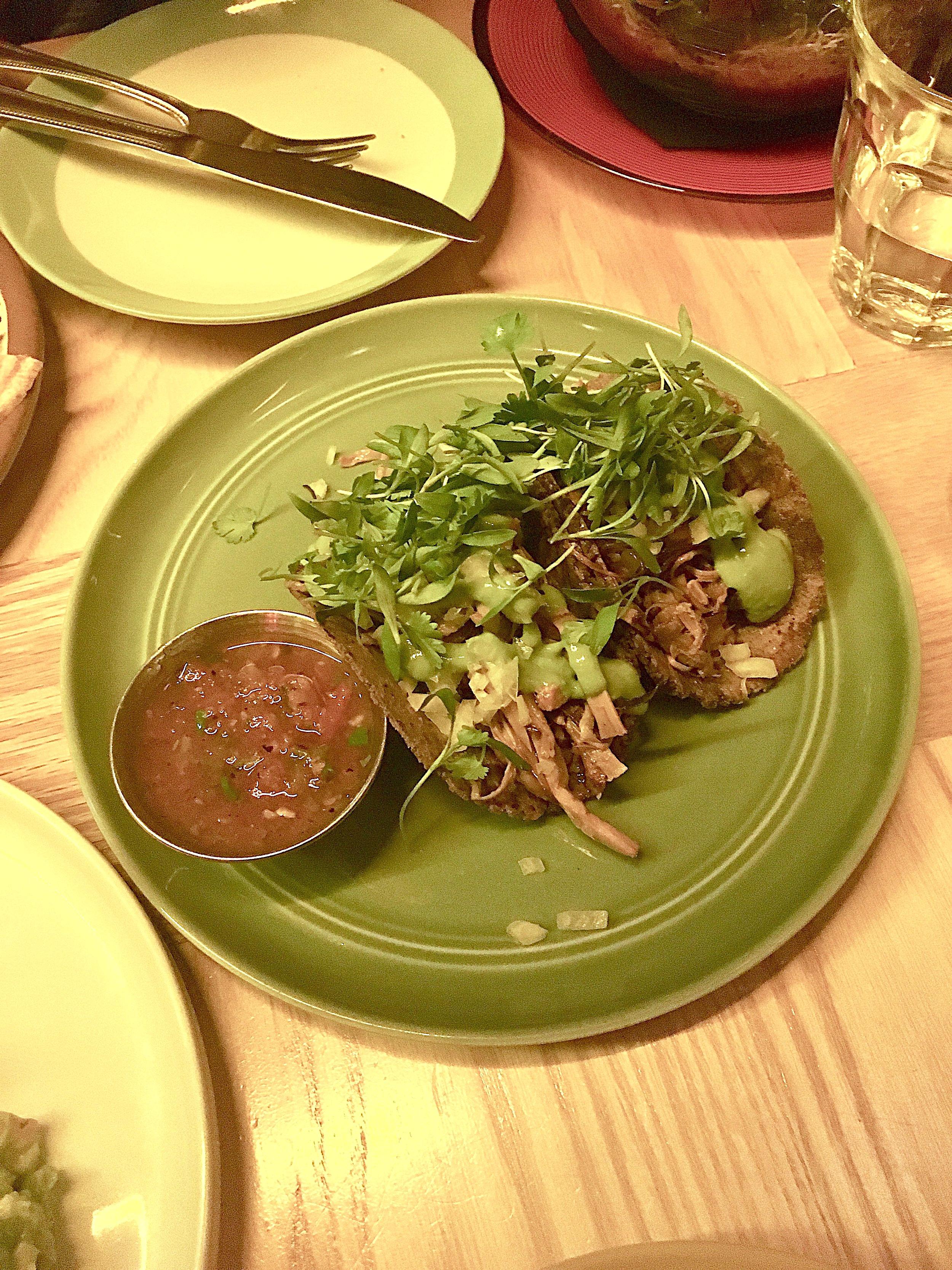palm carnitas tacos // blueberry & flax seed tortilla, hearts of palm, jackfruit, orange, salsa verde, micro cilantro