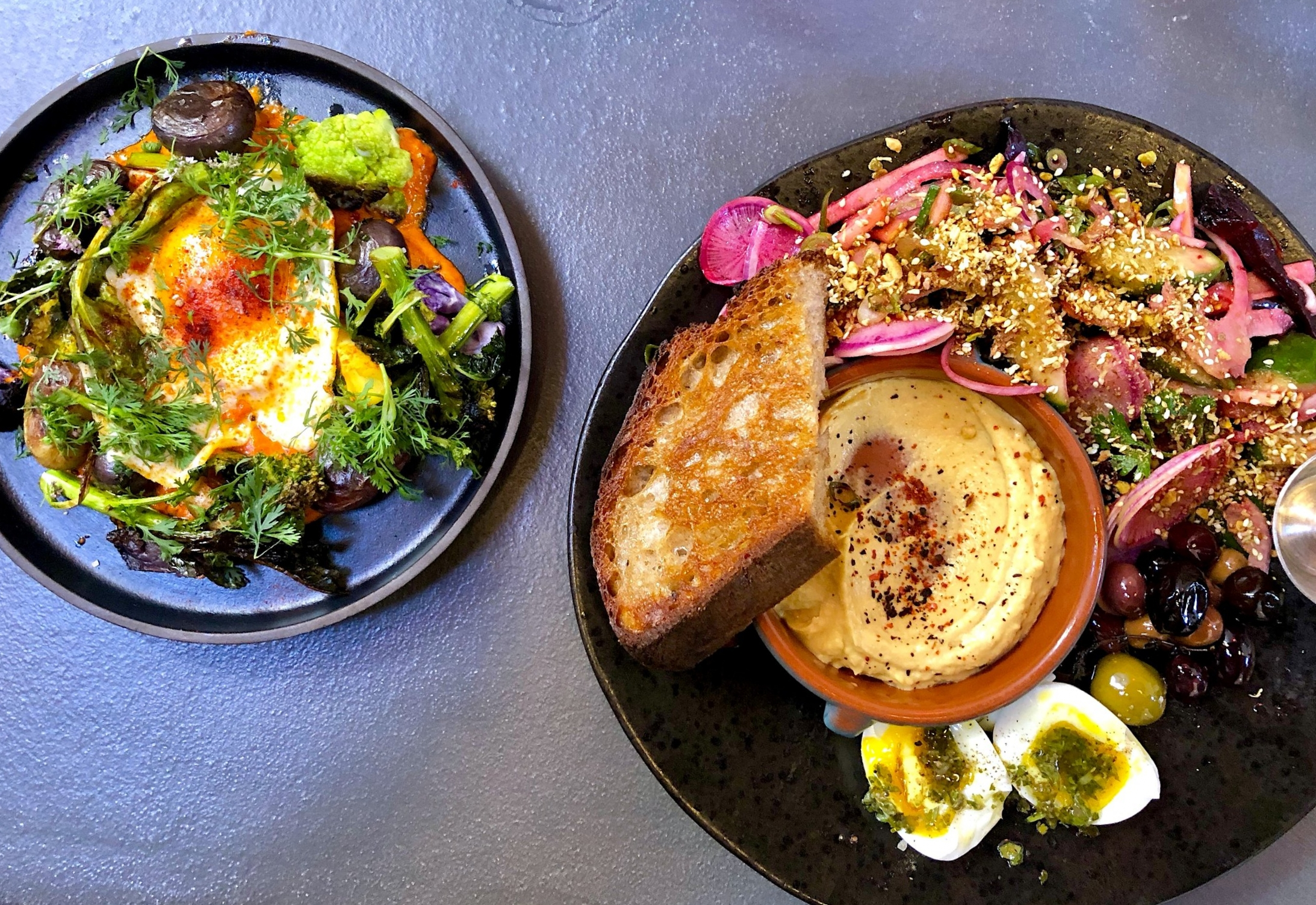 our favorite romesco // seared winter vegetables, charred leeks, peewee potatoes, almonds, cilantro, farm fried egg  morning mezze // roasted squash hummus, roasted beet-apple salad with dukkah, 6-minute egg with salsa verde, marinated olives, Bub & Grandma's bread