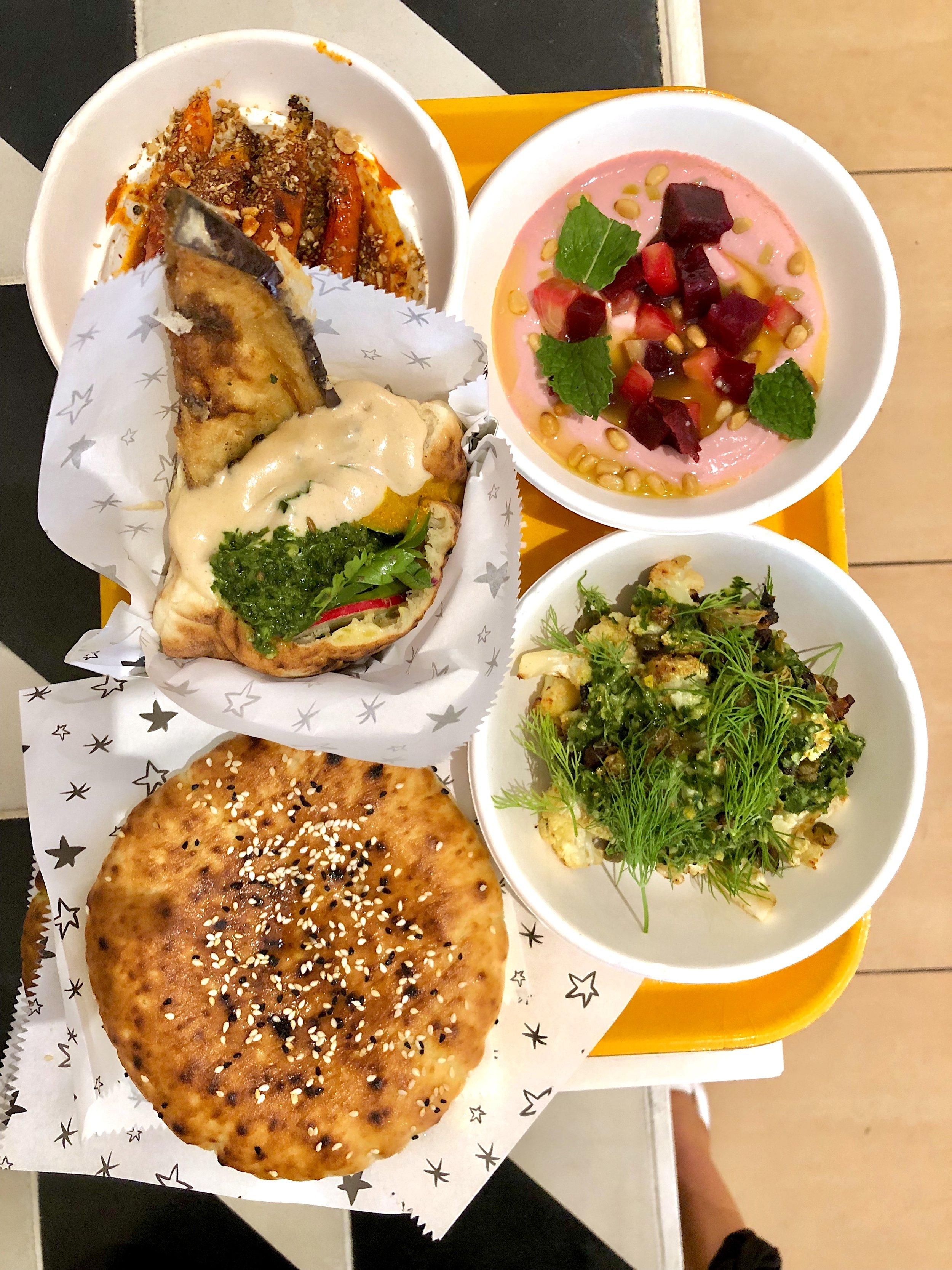 shawarma burger, mezes (carrot, beet, cauliflower), pita bread