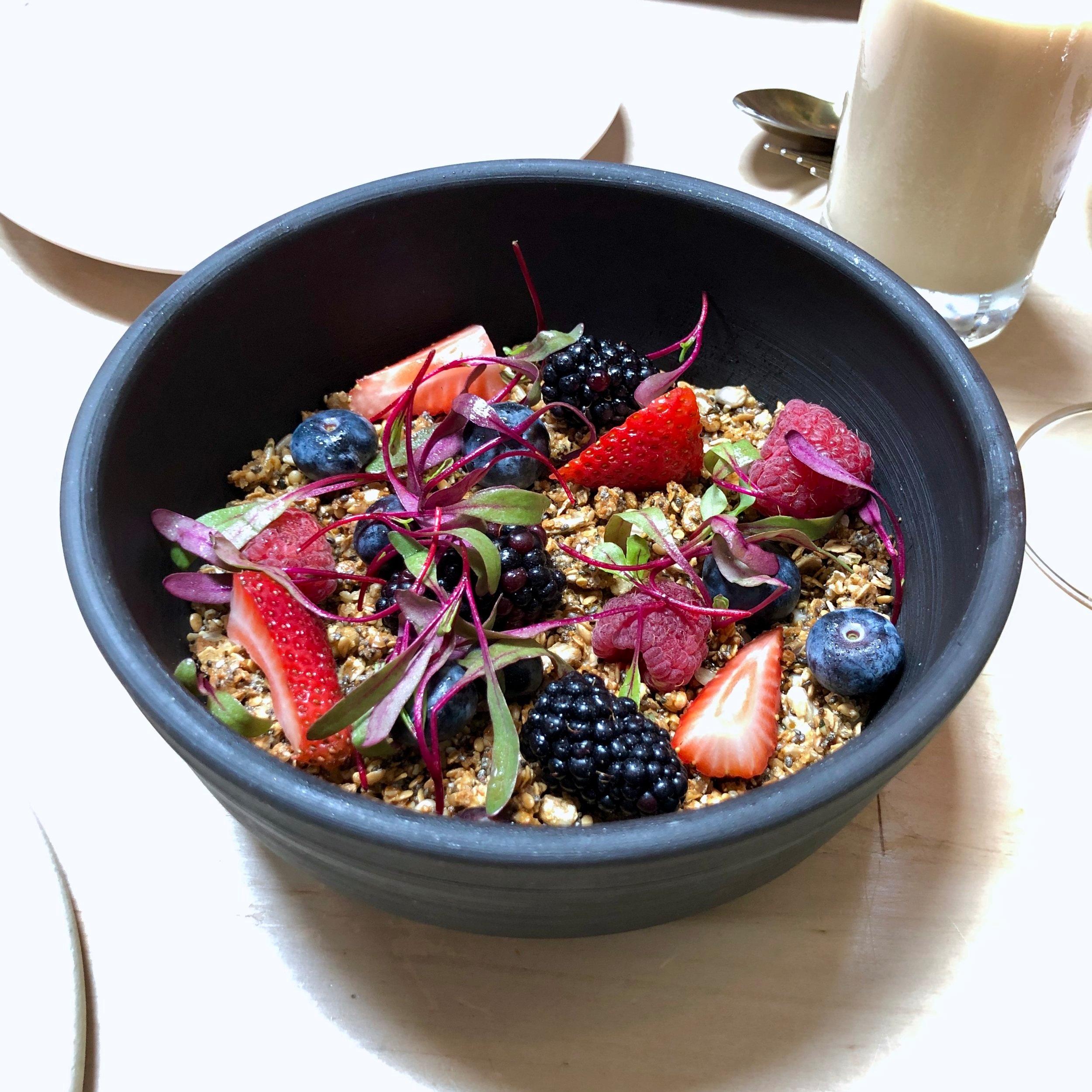 seeded maple granola // coconut yogurt, market berries & herbs