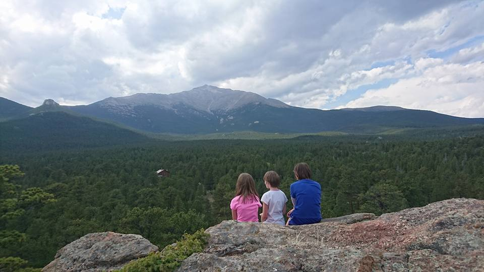 Deb's three girls enjoying the view while hiking in Colorado.