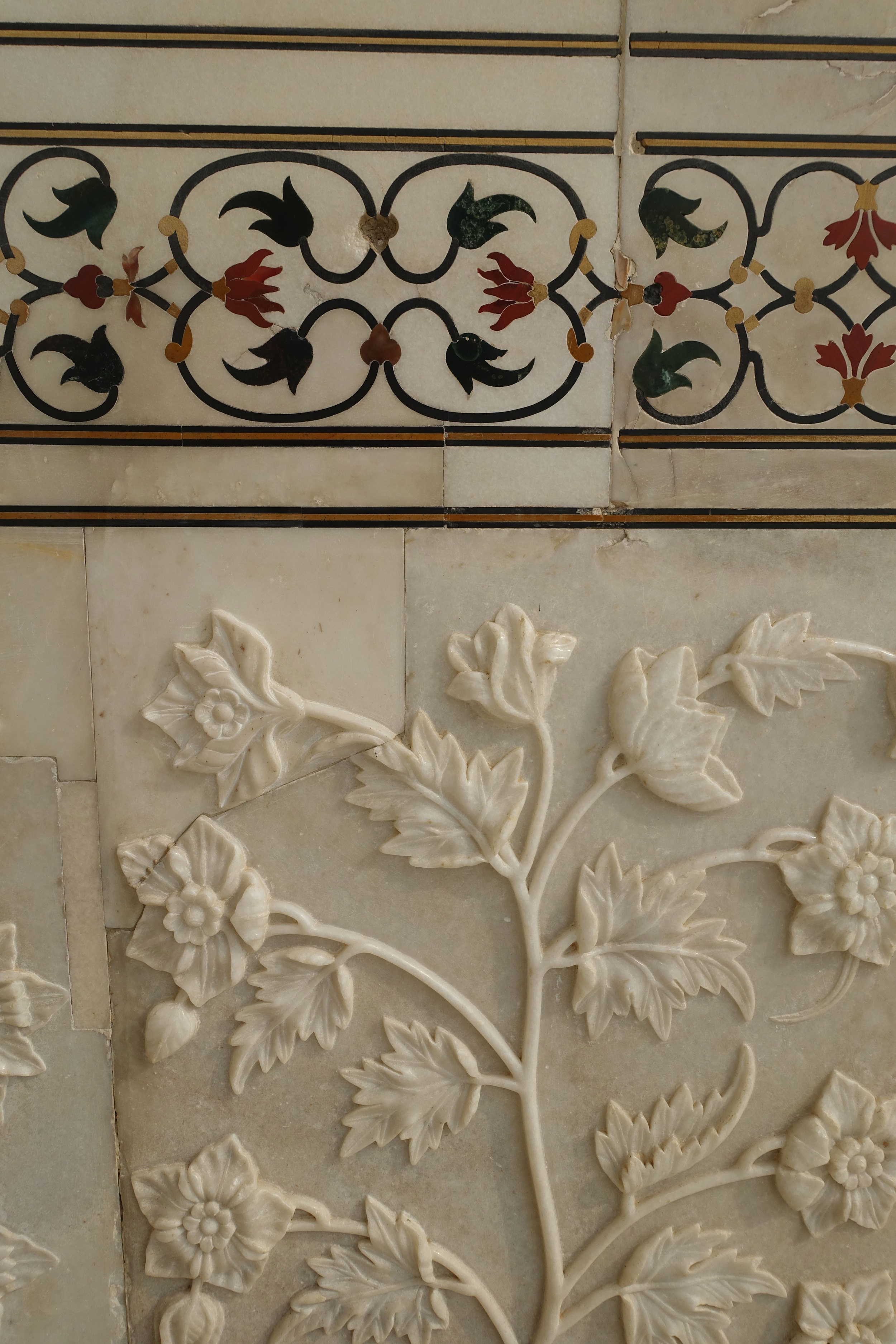 Inlaid semi precious stones and hand carved white marble panels decorated with flowers so   would never be without flowers, are everywhere.