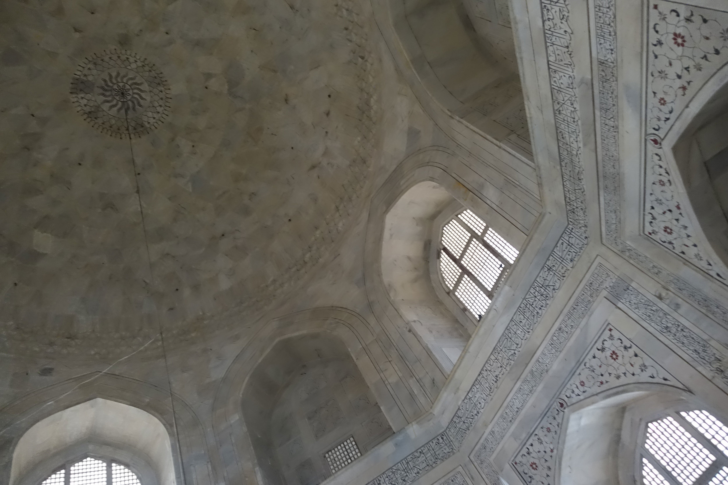 Intricate carvings symmetrical architecture inside the dome