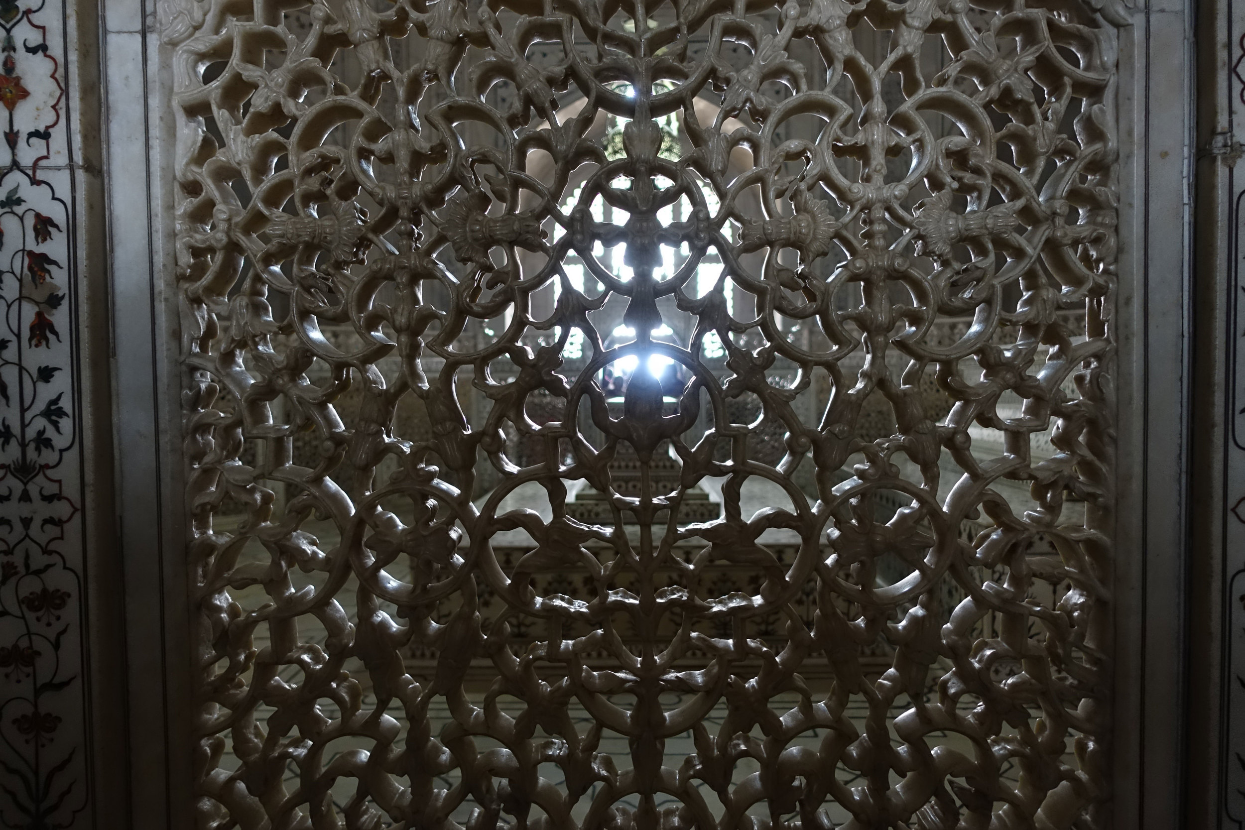 oriental filigree marble carving surround the replica tomb upstairs