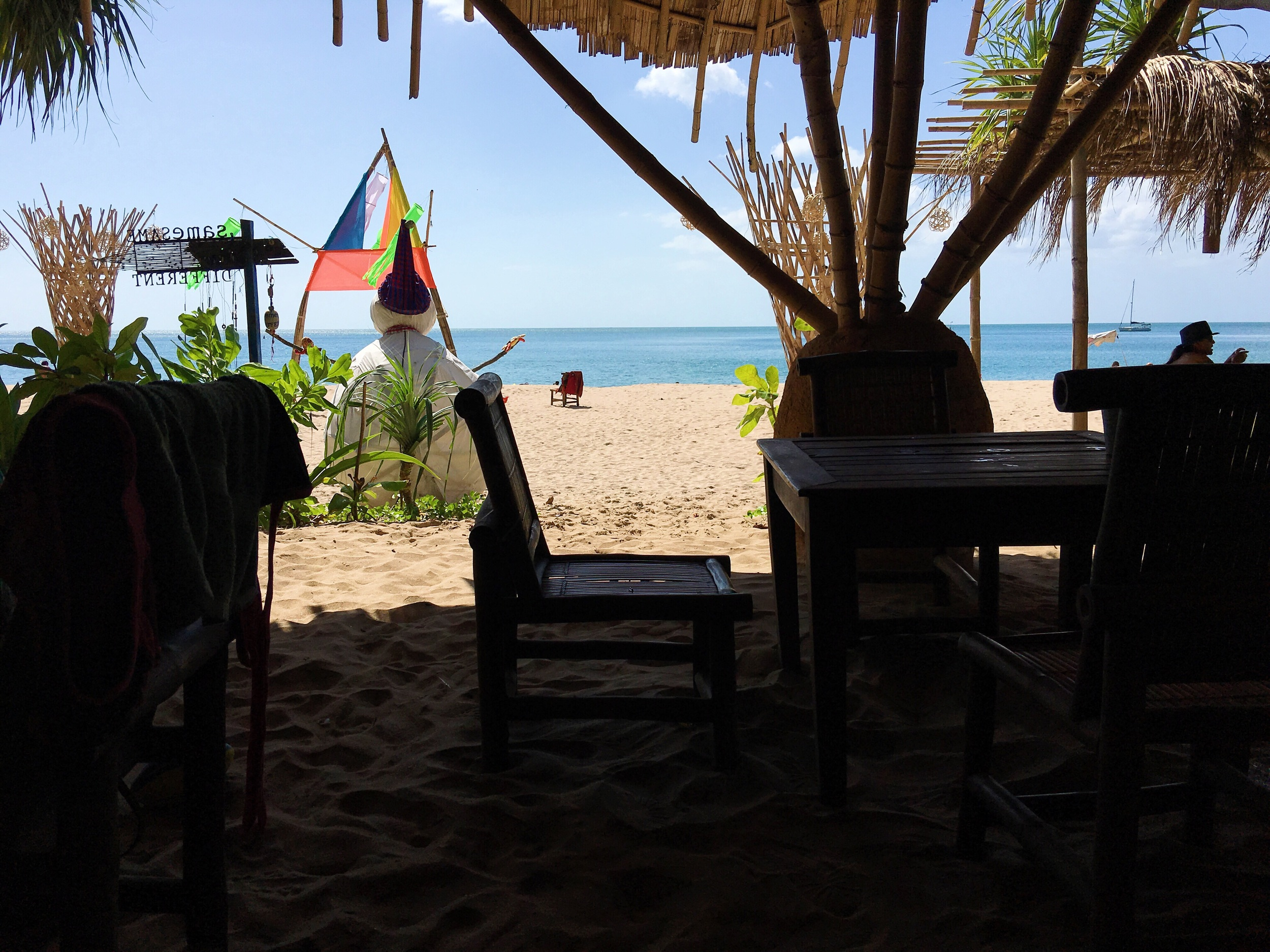 our view from underneath a palapa at Same Same but Different