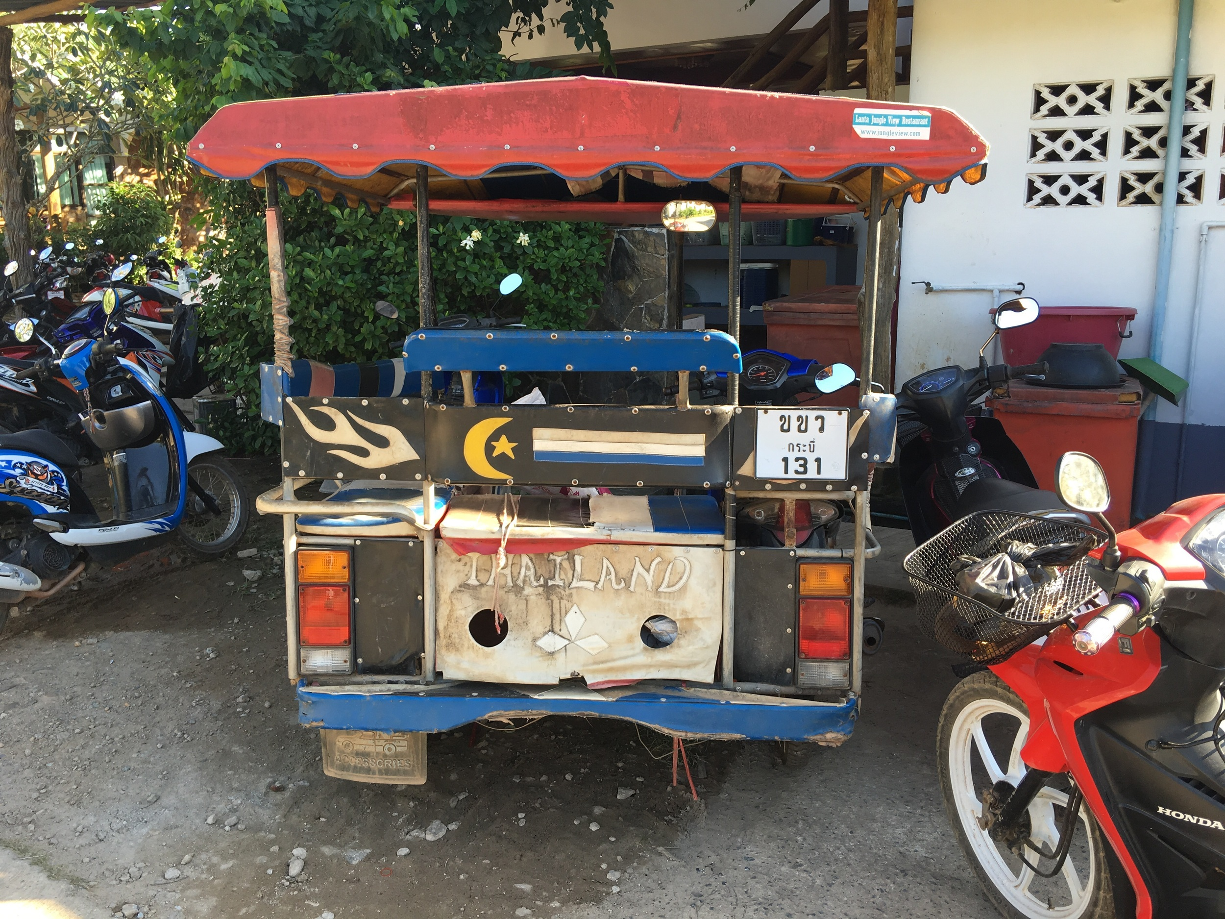the TOK TOK Car, it's a mini motorbike with a metal frame with seats used as a taxi to move people around the island some of them are decorated very ornately (pimped out)with black lights and hanging tassles much nicer than the ones in India