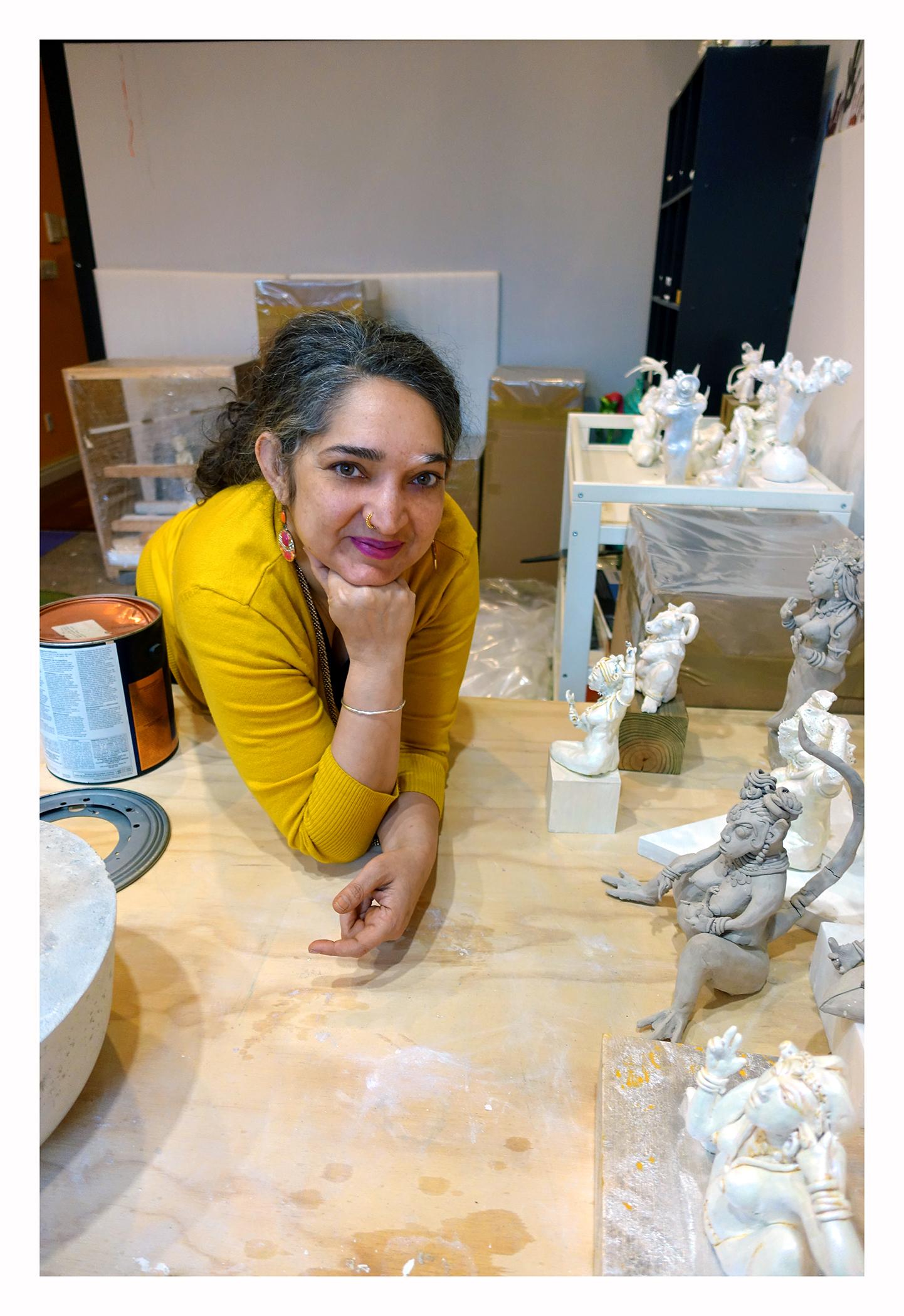 Jaishri Abichandan  i in her Brooklyn Studio surrounded by her    Lajja Gauri   and Yoni inspired Hindi   goddesses  .