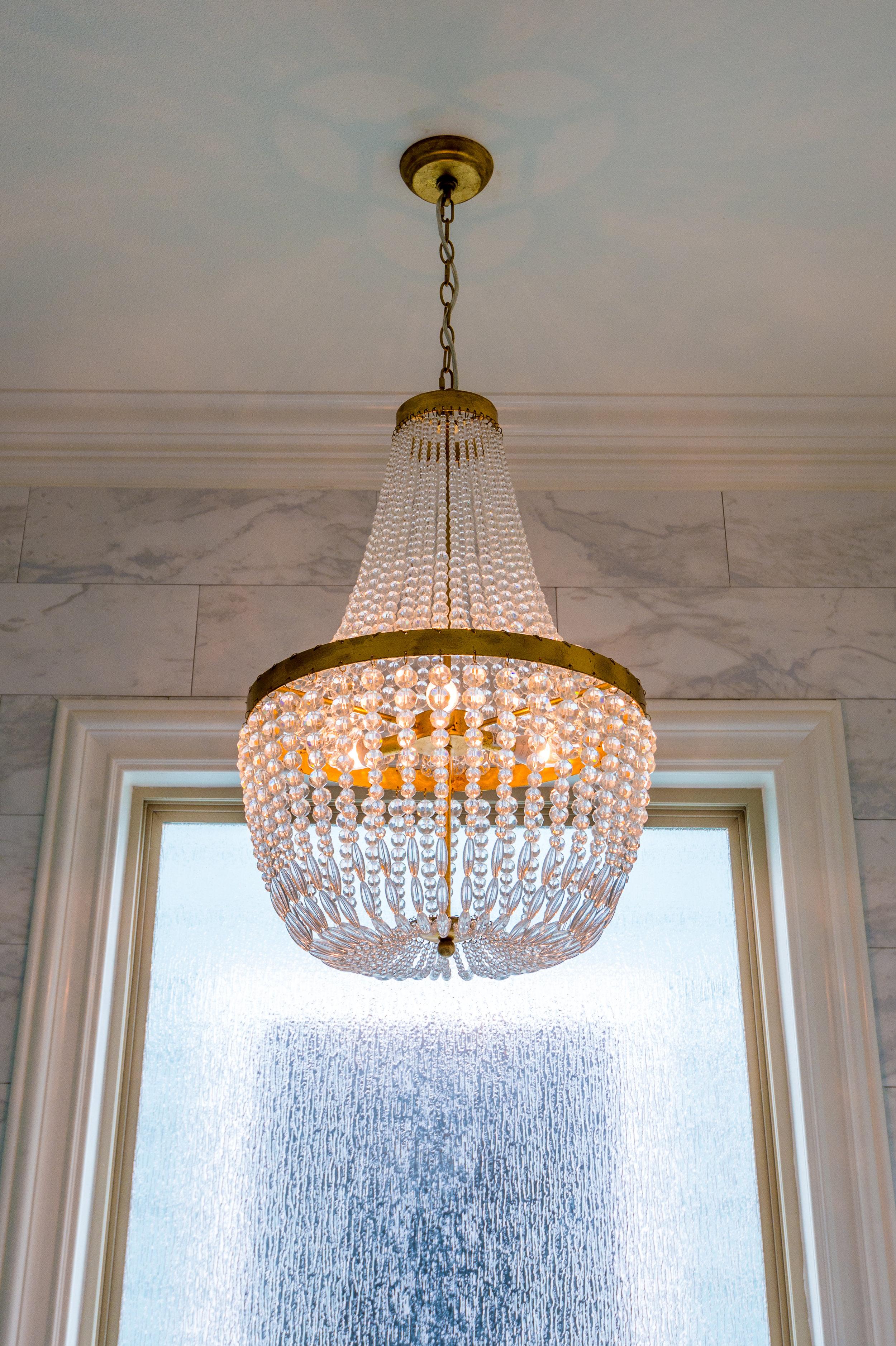 freestanding bathtub chandelier metairie residential interior design khb interiors