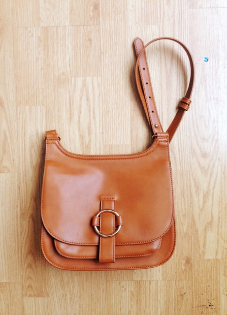 My pretty brown leather saddle bag from  Forever 21 .